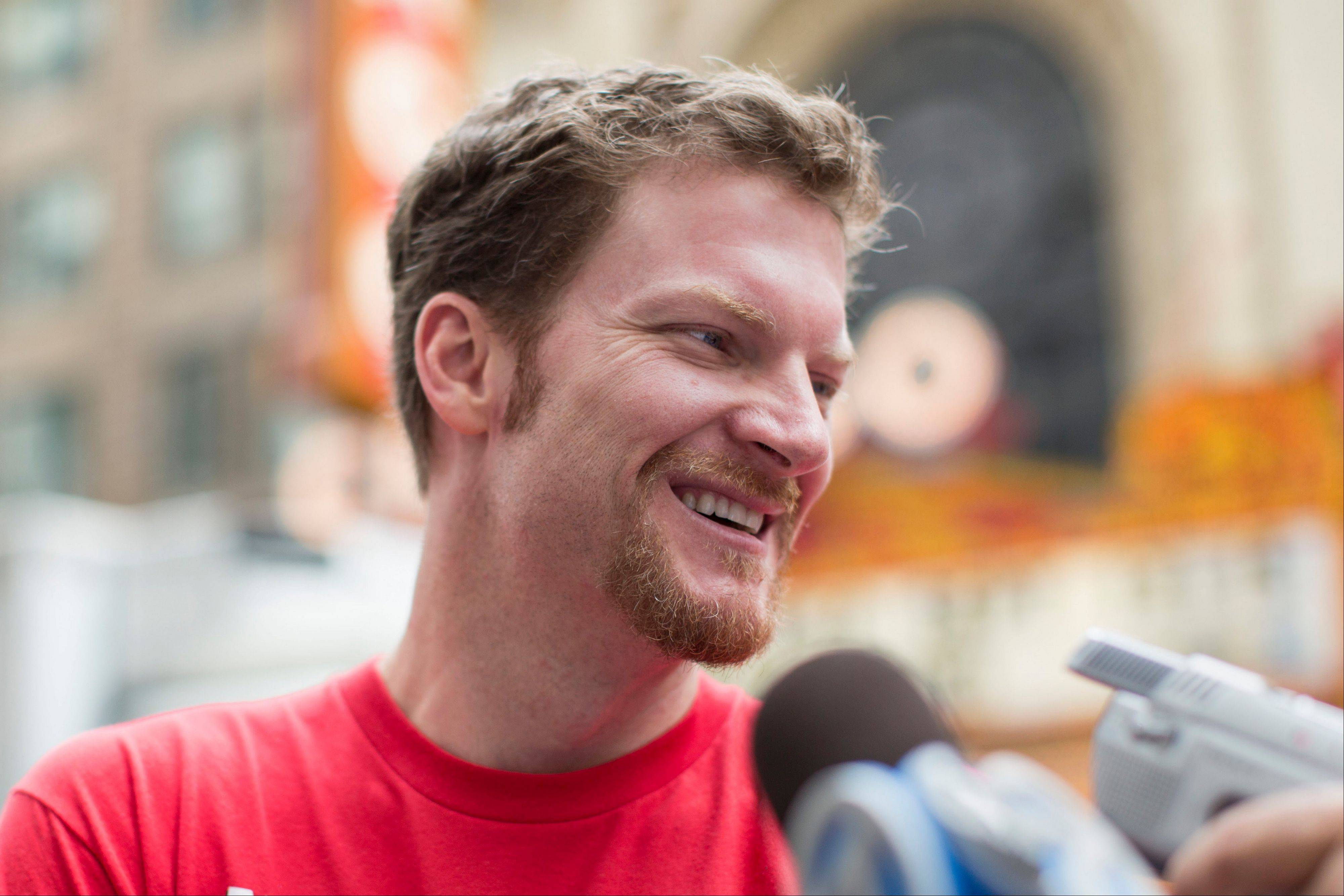 Dale Earnhardt Jr. speaks at a news conference Monday after he performed a burnout in front of the Chicago Theatre.