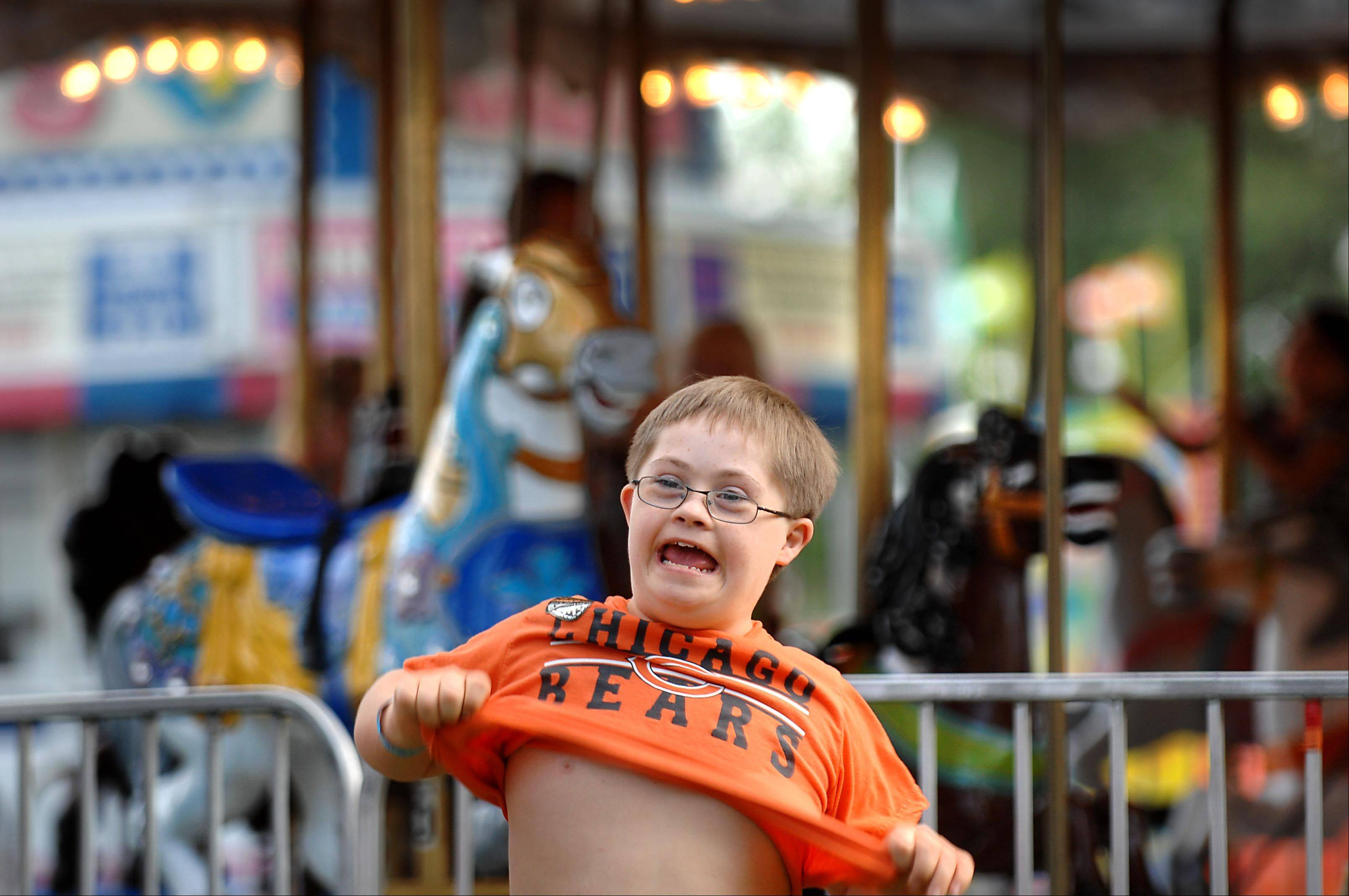 "Joey Picardi, 11, of Bartlett can't wait for his turn on the slide during last year's ""A Special Night for Special Kids"" at the South Elgin RiverFest Express. Kids with special needs and their families are allowed free rides and food 6 to 9 p.m. Wednesday to enjoy the festival before the crowds start Thursday. The festival runs Thursday, Aug. 15, through Sunday, Aug. 18, at Panton Mill Park."