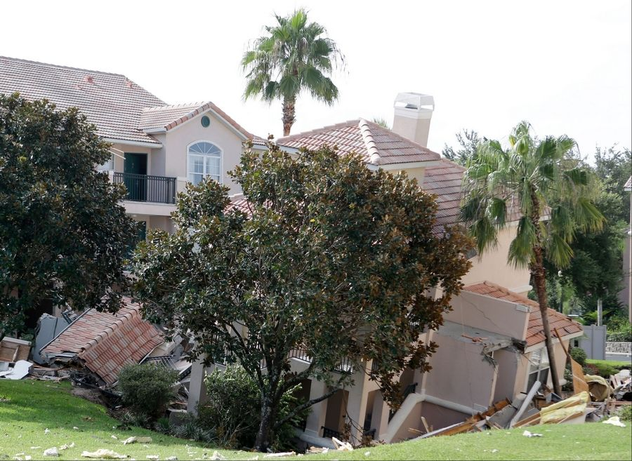 A portion of a building at the Summer Bay Resort rests in a sinkhole Monday in Clermont, Fla. The sinkhole, 40 to 50 feet in diameter, opened up overnight and damaged three buildings at the resort.