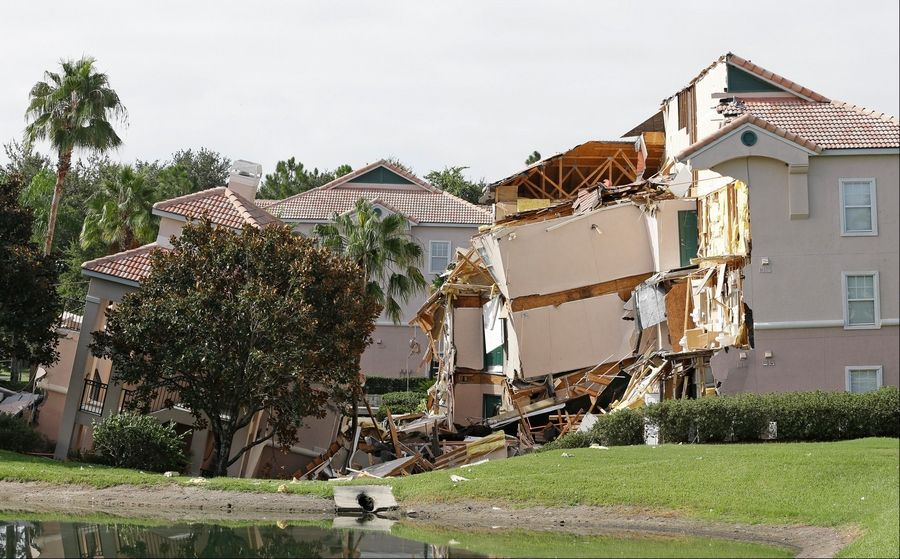 A sinkhole is damaging buildings at the Summer Bay Resort in Clermont, Fla.