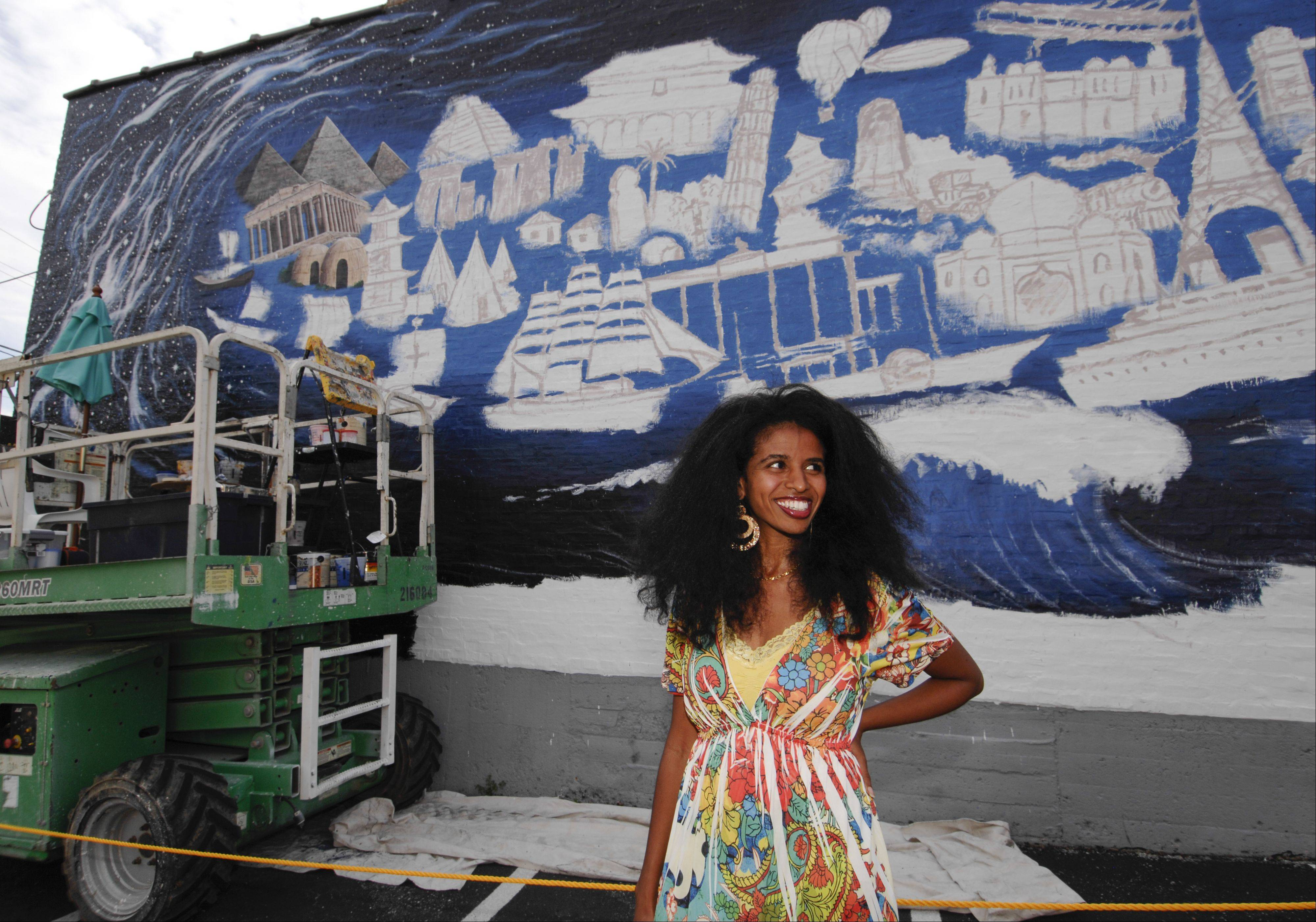 Wheaton resident Mehret Asgedom's poem inspired the mural by artist R.J. Ogren that will celebrate the city's diversity and the contributions of its many immigrants.