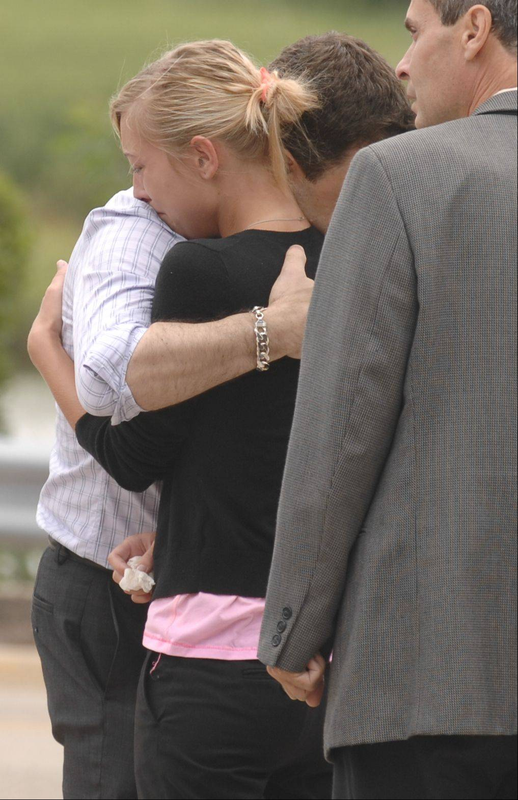 Linnea Nodarse, sister of Jacob Nodarse, grieves Monday with family members outside the DuPage County Court building after her brother was sentenced to 75 years in prison or the triple murder of members of the Kramer family in Darien in 2010.