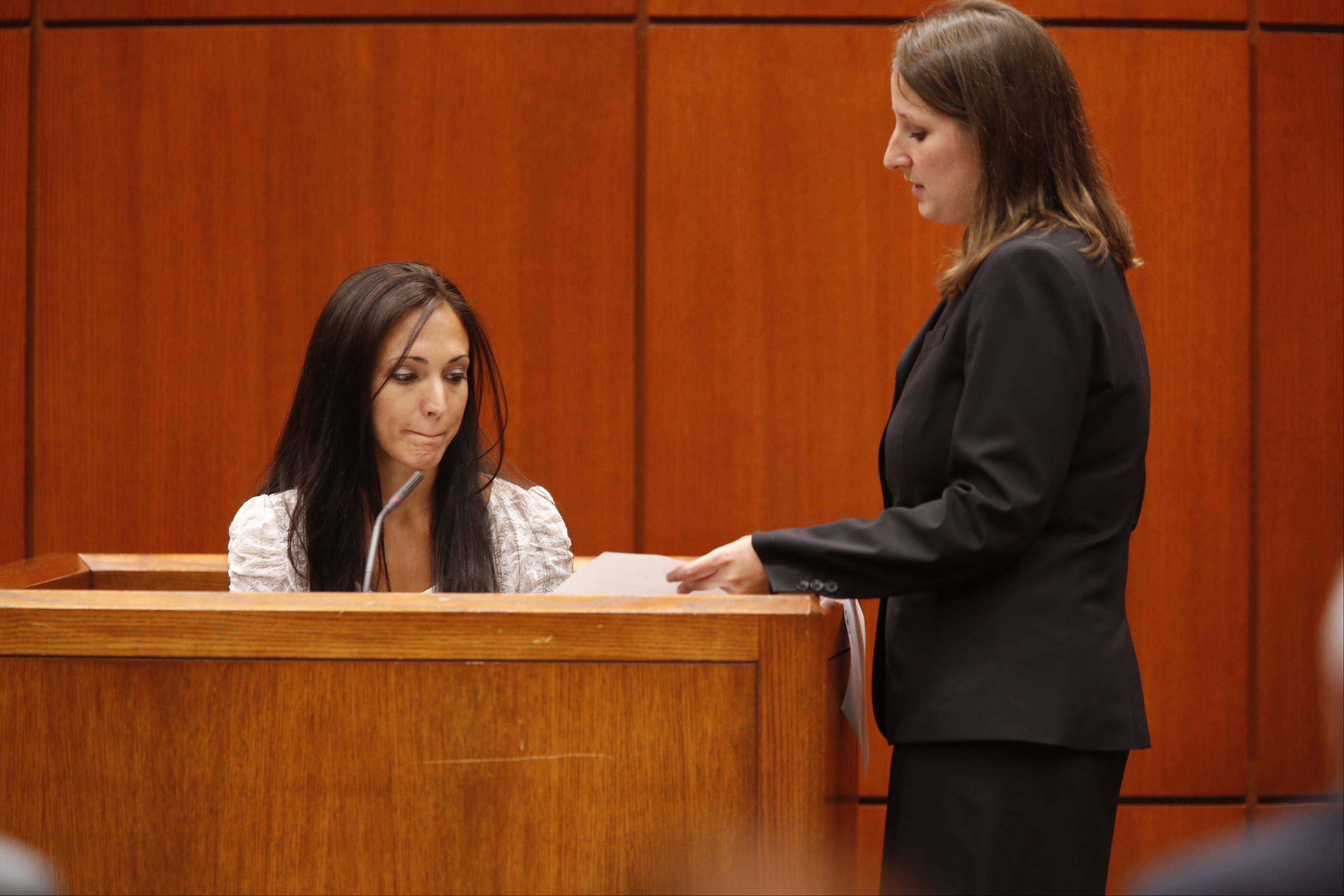 Angela Kramer, left, the daughter of Jeffrey and Lori Kramer and the sister of Michael Kramer, reads her impact statement Monday at the sentencing of Jacob Nodarse at the DuPage County Courthouse in Wheaton.