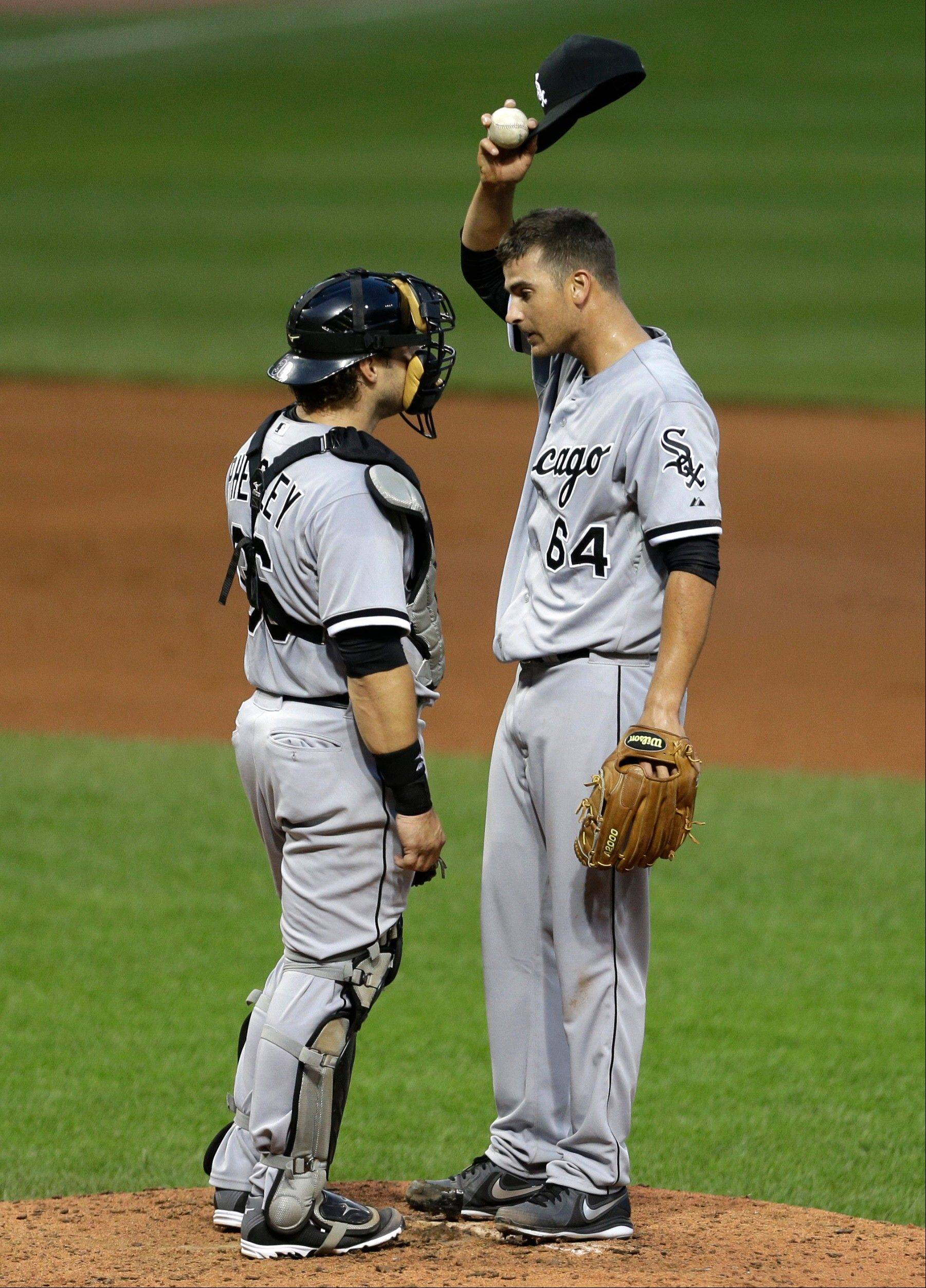 White Sox catcher Josh Phegley talks with starter Andre Rienzo during a recent game in Cleveland.