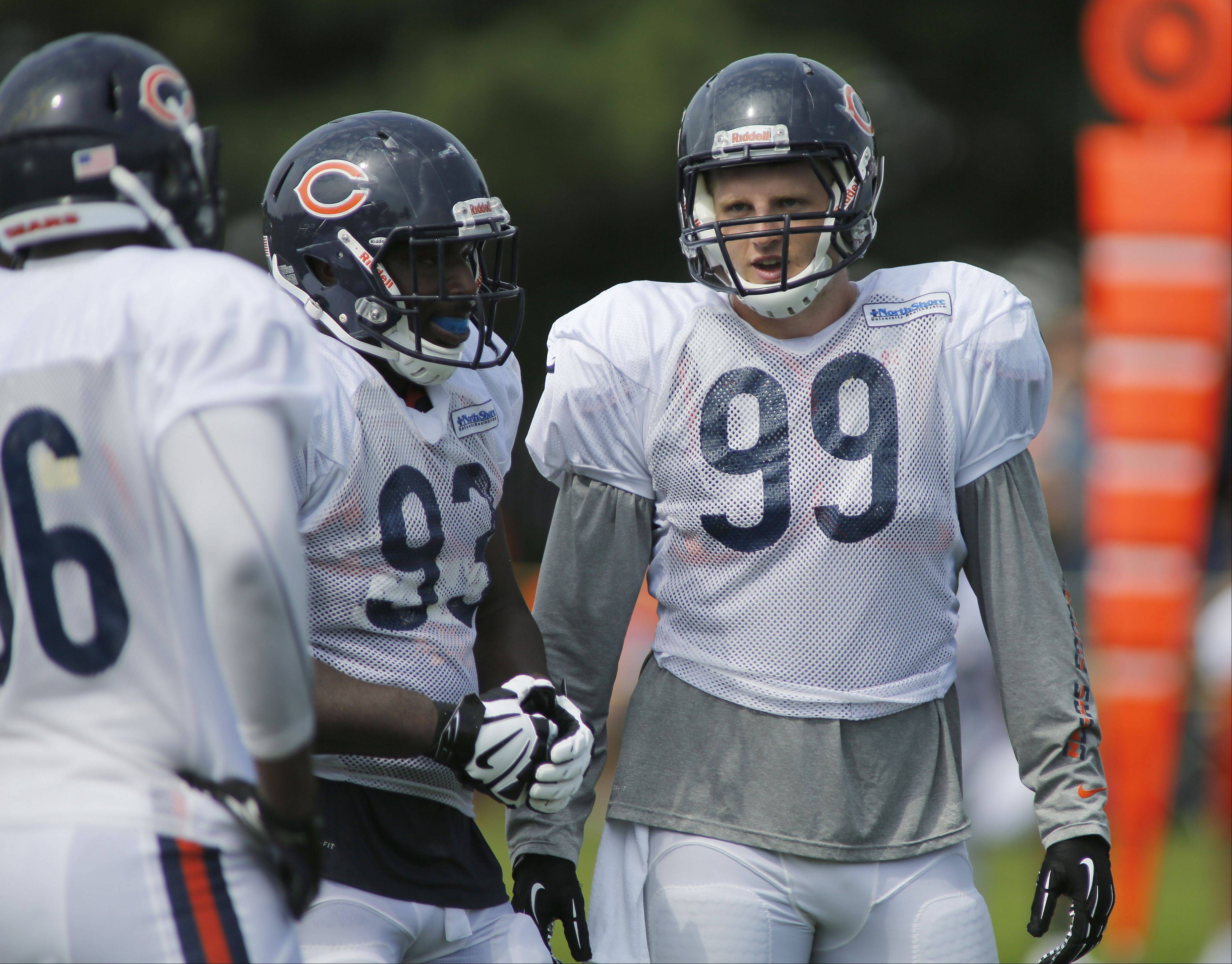 Bears defensive linemen Nate Collins (93) and Shea McClellin (99) are vying for playing time in Bears training camp at Olivet Nazarene University in Bourbonnais. Both should see plenty of action in Thursday's second exhibition game.