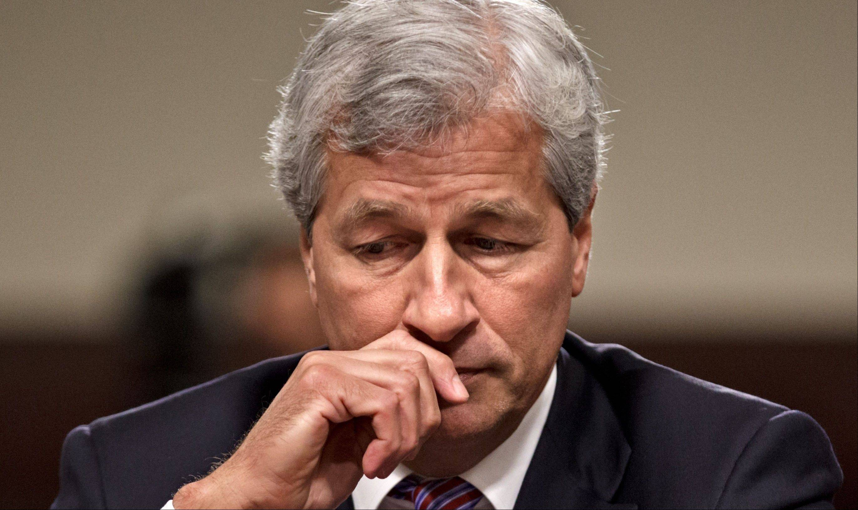 In this Wednesday, June 13, 2012, photo, JPMorgan Chase CEO Jamie Dimon testifies on Capitol Hill in Washington. Dimon has said JPMorgan is undergoing �extensive changes� to its business practices, and that regulatory compliance is its top priority.