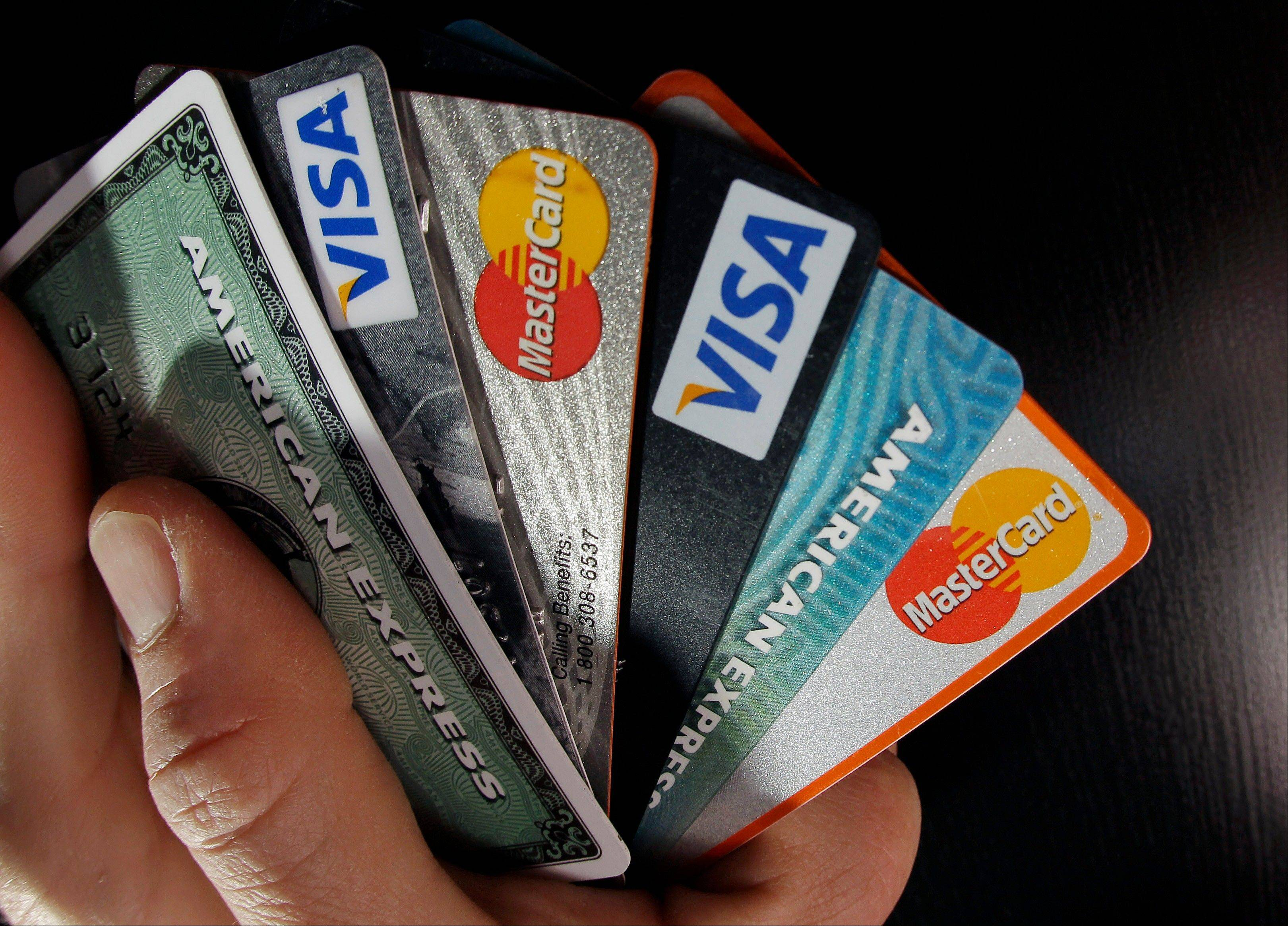 Americans remain stingy about carrying credit card balances and are making more of an effort to make timely payments, trends that have helped whittle the rate of late payments on credit cards down to the lowest level in nearly 20 years.