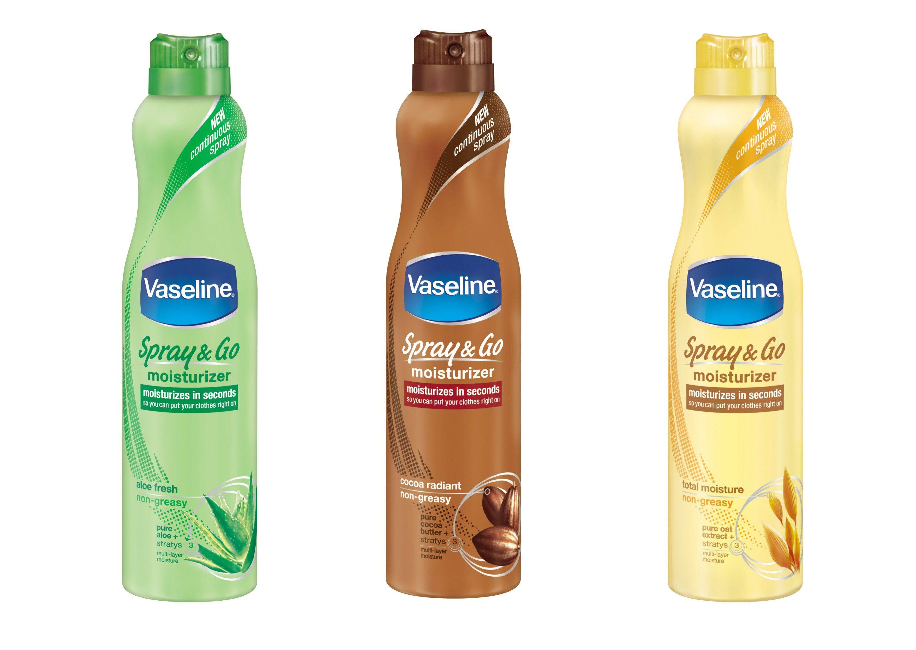 Vaseline's new spray body lotion line, from left, aloe, cocoa butter and oat extract.