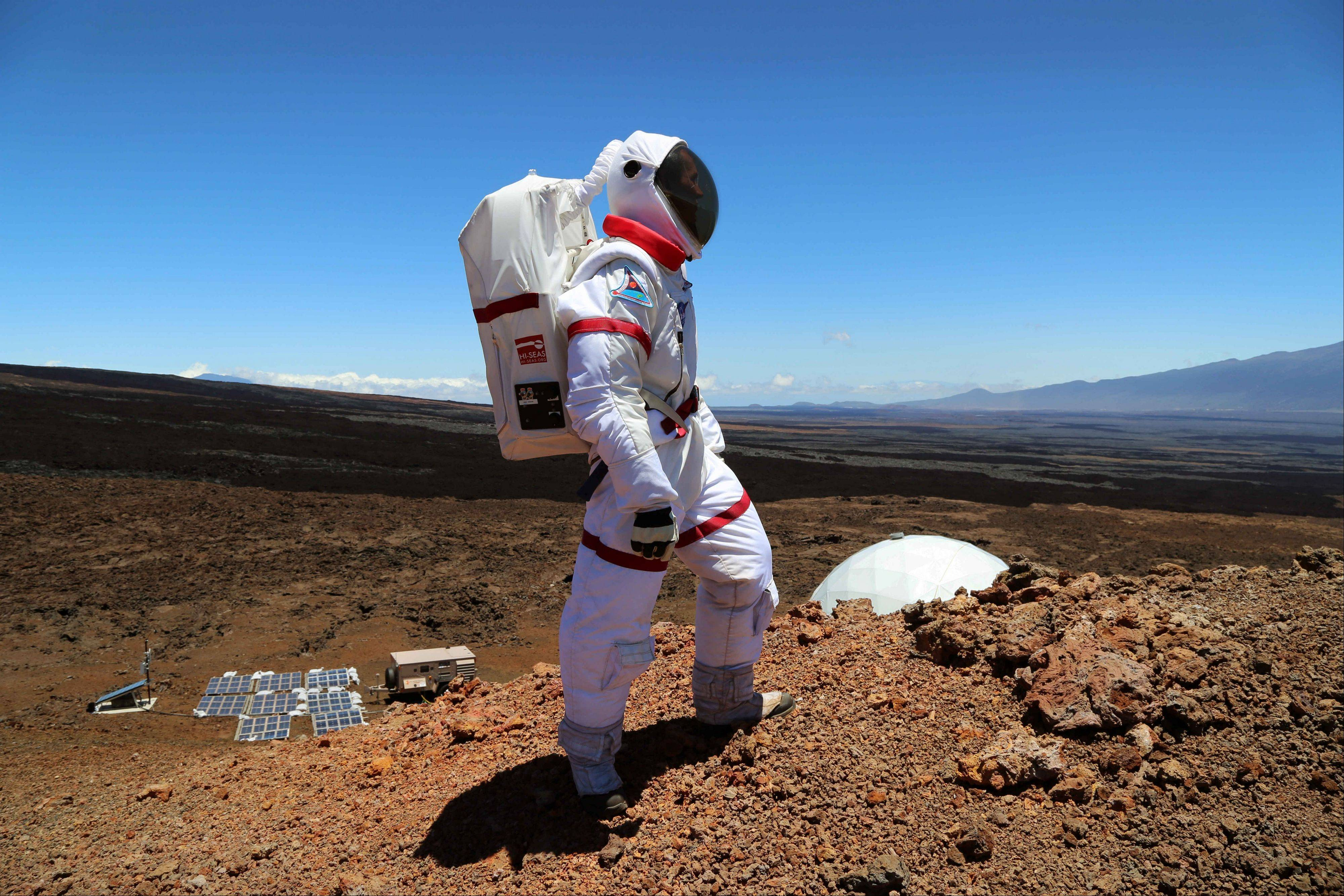Research space scientist Oleg Abramov walks outside simulated Martian base at Mauna Loa, Hawaii. Six researchers have spent the past four months living in a small dome on a barren Hawaii lava field at 8,000 feet, trying to figure out what foods astronauts might eat on Mars and during deep-space missions.