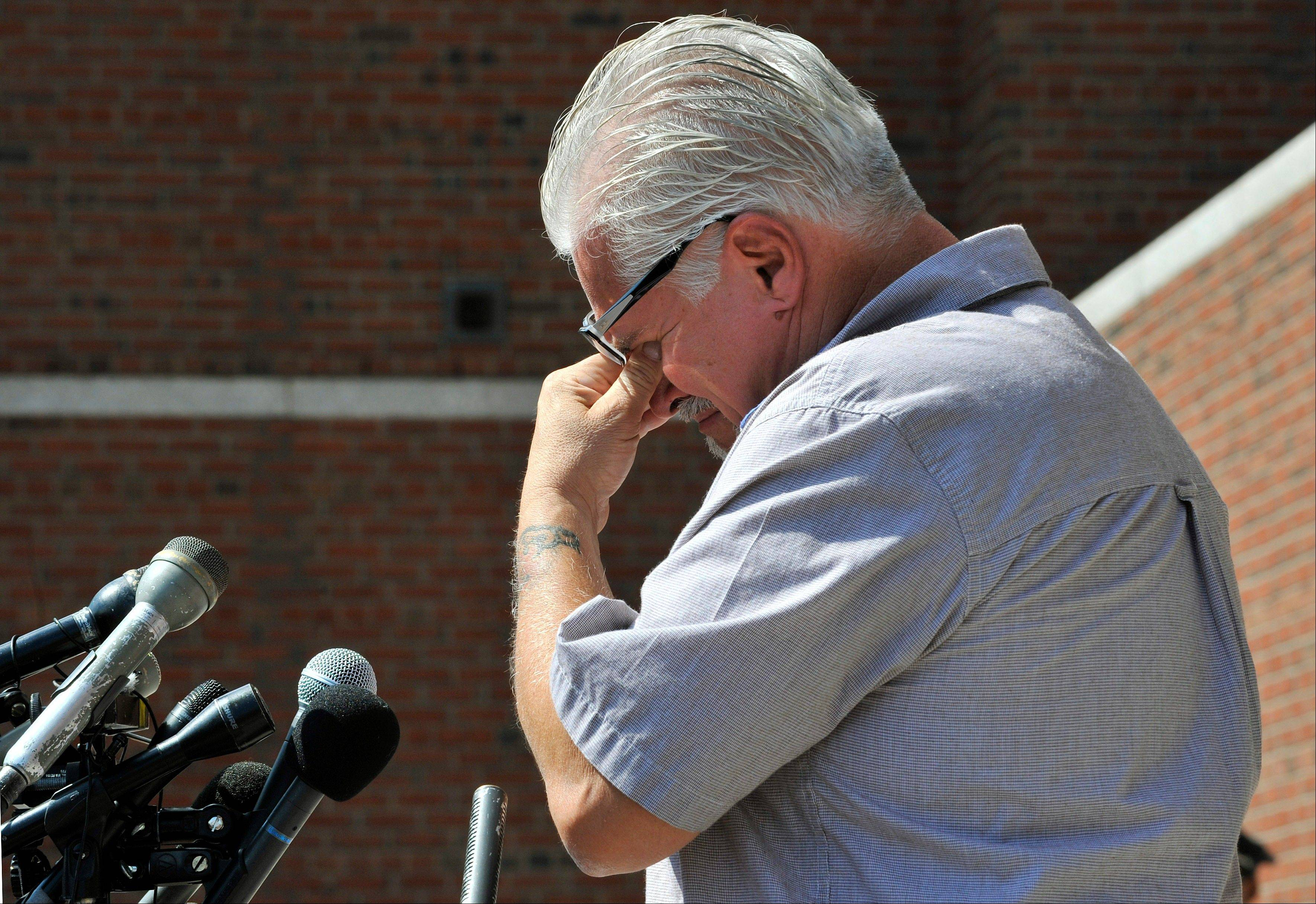 Steven Davis, brother of Debra Davis, wipes his eyes while speaking outside federal court where a jury found James �Whitey� Bulger guilty on several counts of murder, racketeering and conspiracy Monday, Aug. 12, 2013 in Boston. Jurors could not agree whether Bulger was involved in Debra Davis� killing.