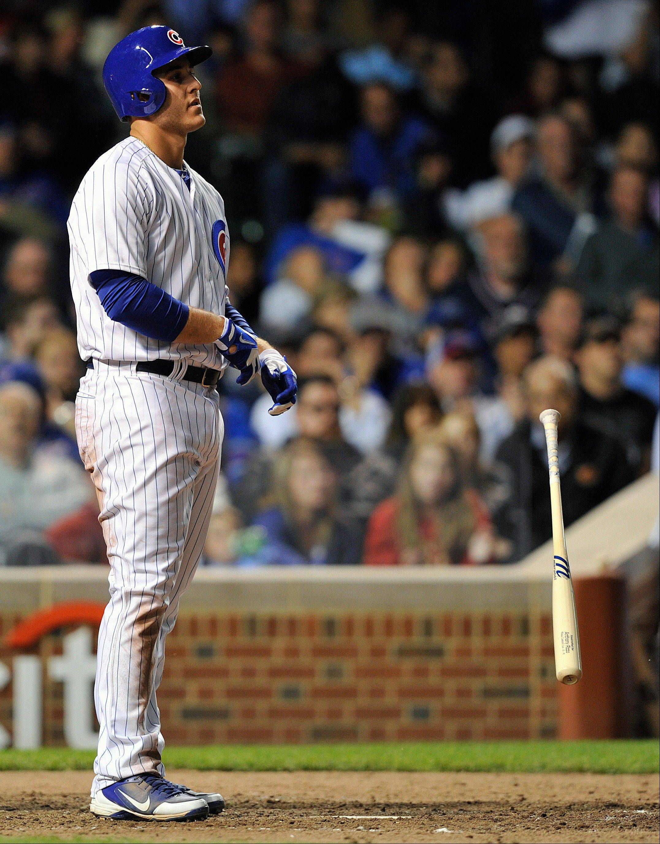 The Cubs� Anthony Rizzo tosses his bat after striking out against the Cincinnati Reds during Tuesday�s seventh inning at Wrigley Field.