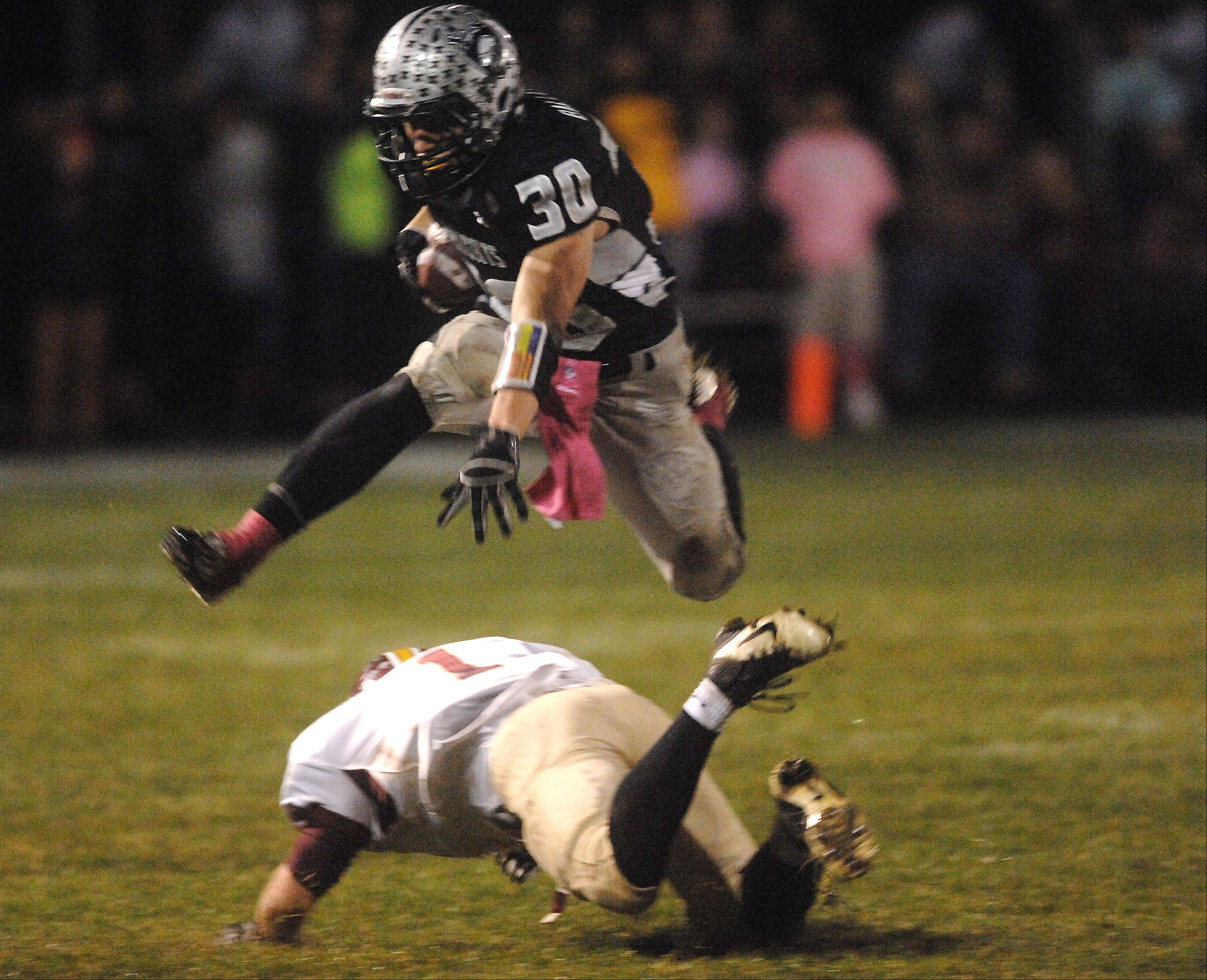 Jesse Balluff, pictured hurdling a would-be Morris tackler during last year�s Northern Illinois Big XII East Conference-clinching 33-30 win, will be one of the key players on a Kaneland team that enters the season on a 28-game regular season winning streak.