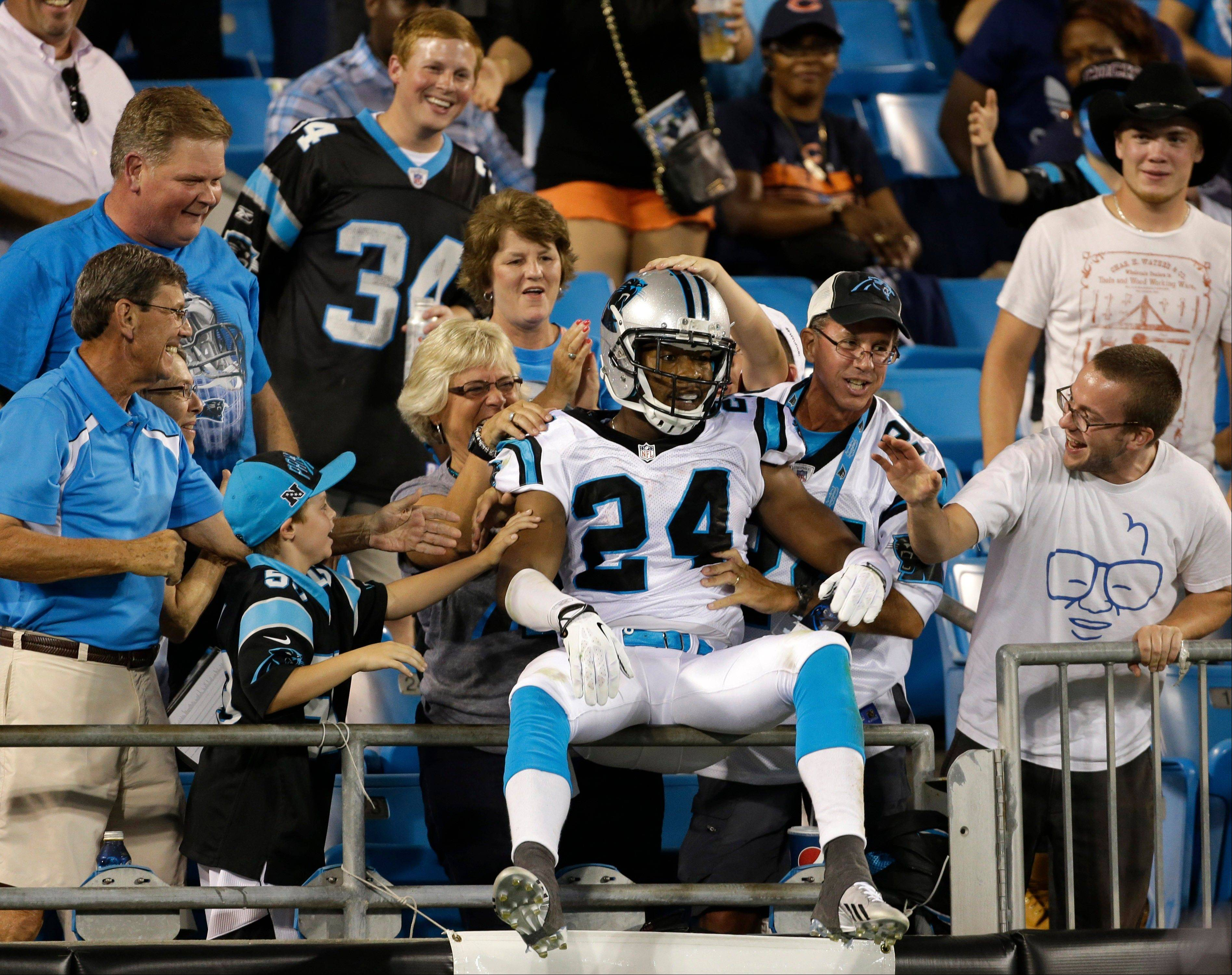 Carolina Panthers defensive back Josh Norman grabs a seat in the stands after his interception return against the Bears on Friday. Mike North wants Chicago fans to pull up a seat on Sunday mornings for his new radio show on AM560 The Answer. The two-hour pregame program debuts on Sept. 8 before the Bears' home opener.