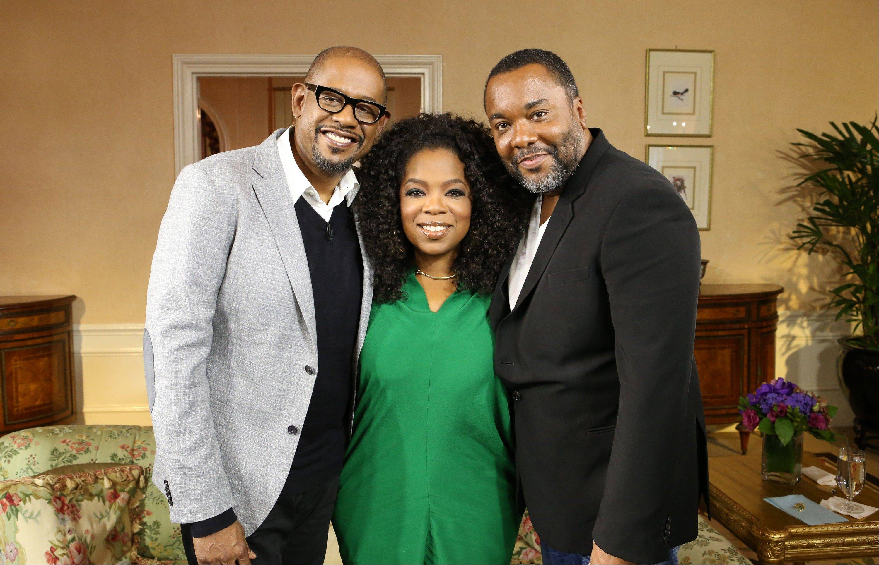 "Forest Whitaker, left, Oprah Winfrey, and director Lee Daniels promoting ""Lee Daniels' The Butler"" at the Waldorf Astoria in New York. The film opens nationwide on Aug. 16."