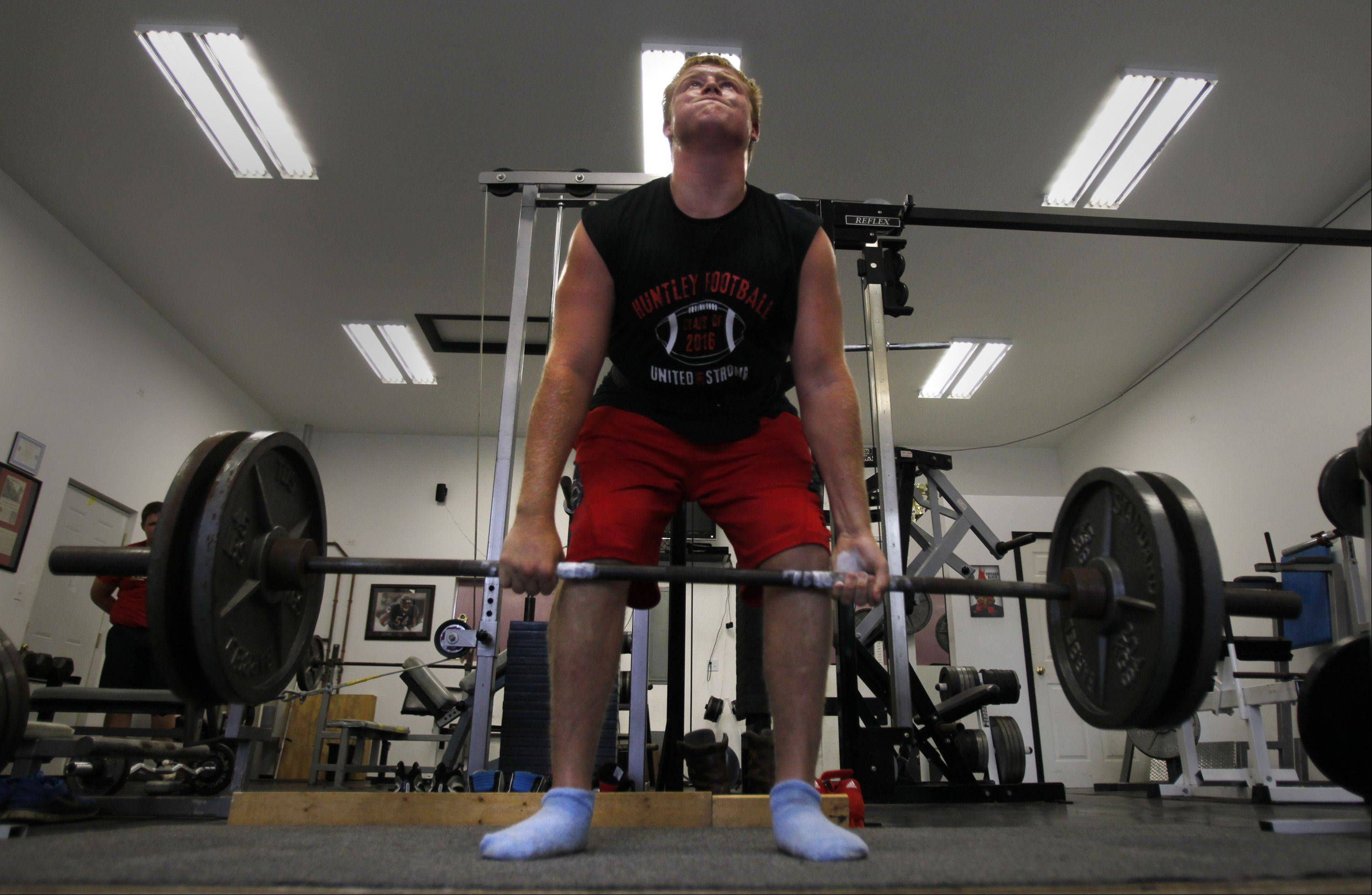 Dominic Swanson, a sophomore at Huntley High School, is heading to Prague in October to compete in a powerlifting competition. Here he dead lifts 305 pounds during a workout at home.