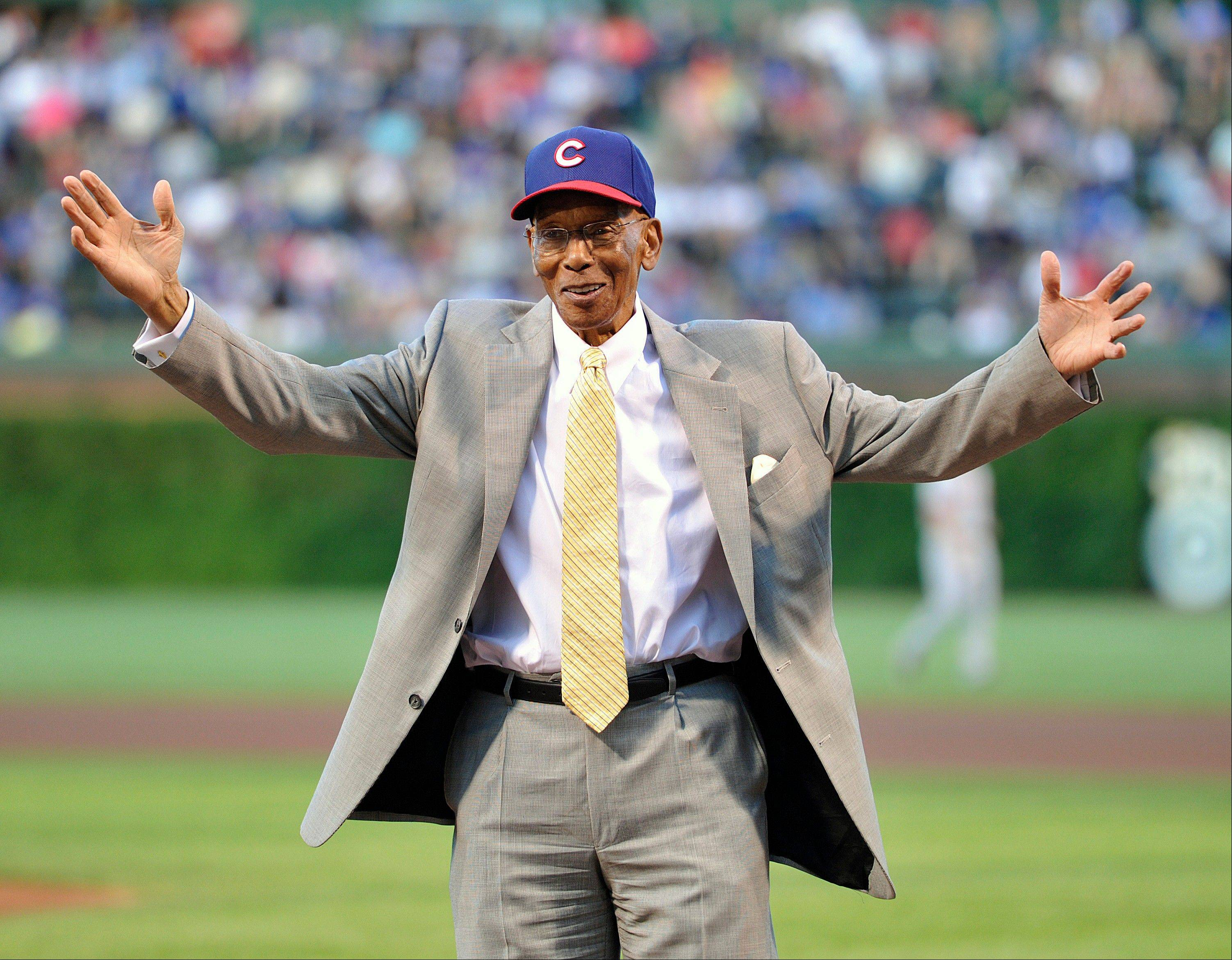 Ernie Banks waves to the crowd before the Cubs' game against the Cincinnati Reds on Tuesday night. Mr. Cub is among 16 people President Obama will honor later this year with the Presidential Medal of Freedom.