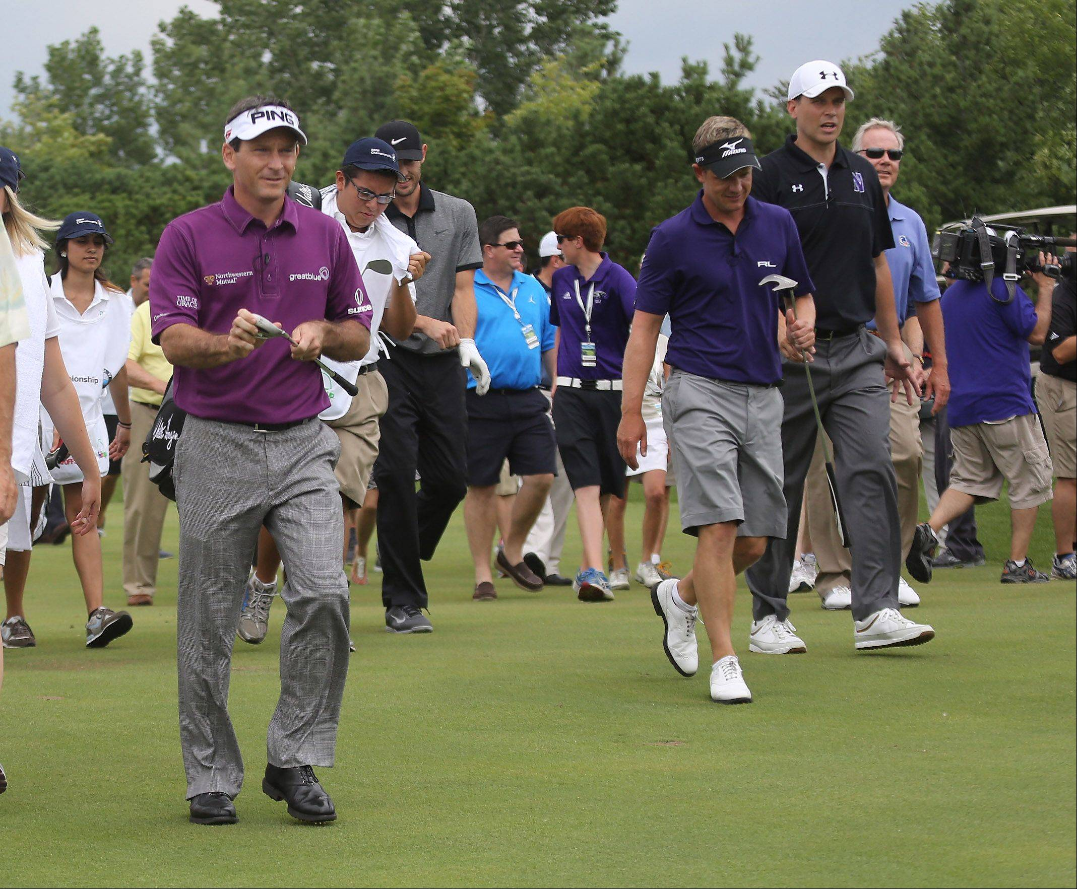 PGA Tour pros Mark Wilson, left, and Luke Donald, center, joined Bulls guard Kirk Hinrich and Northwestern University basketball coach Chris Collins, right, for a BMW Championship exhibition Monday at Conway Farms Golf Club in Lake Forest. The event raised $45,000 for the Evans Scholars Foundation. The BMW Champion will take place Sept. 9-15.