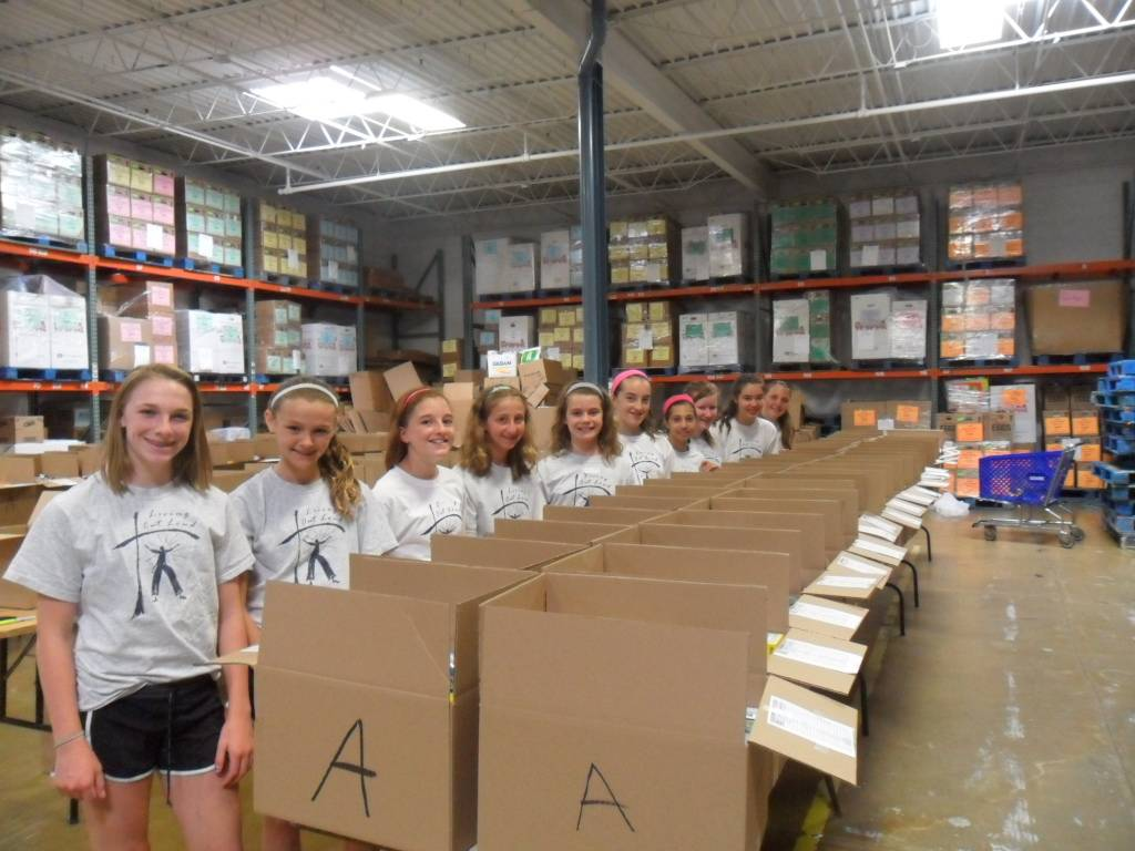 Living out Loud volunteers in HSP's warehouse.