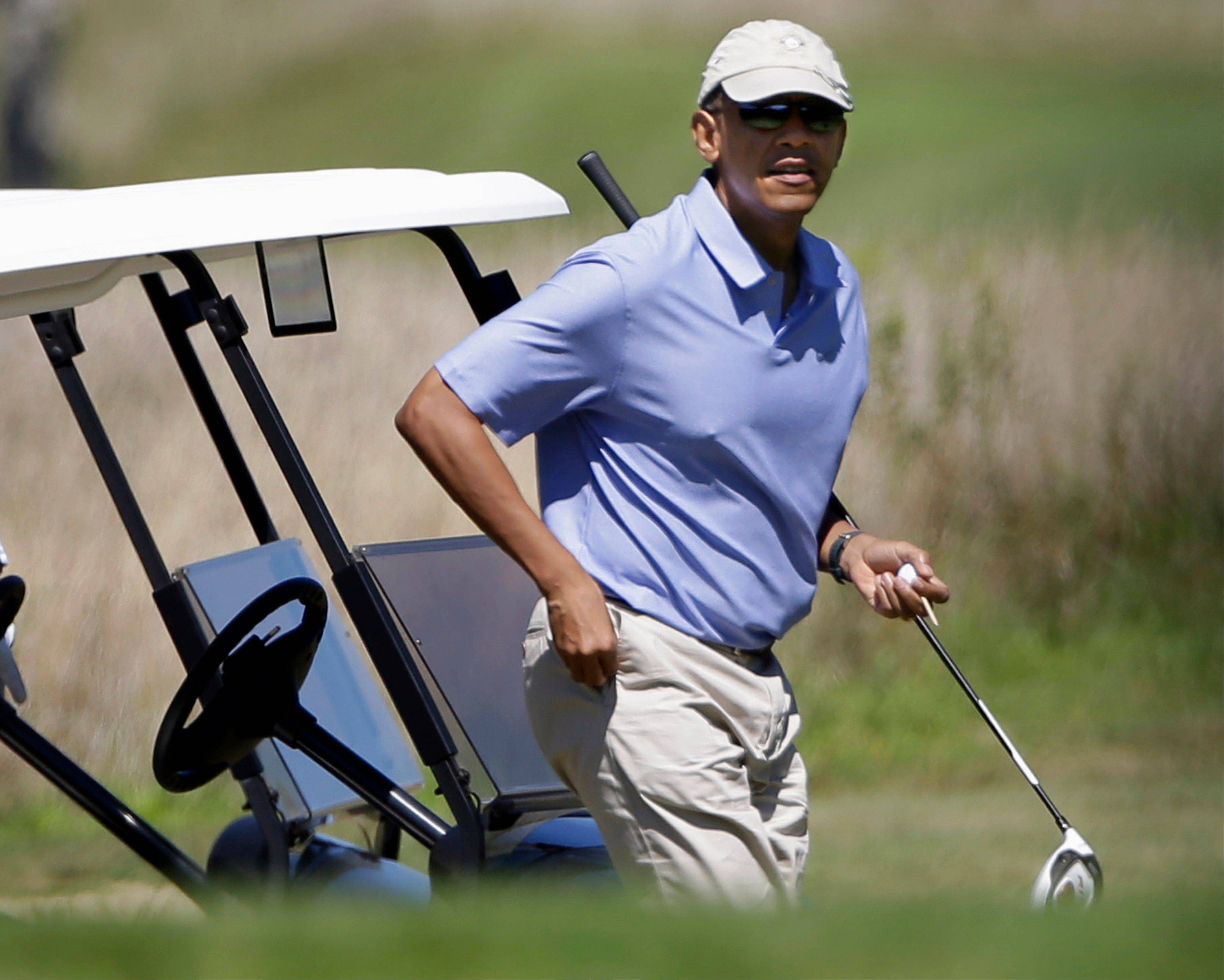 President Barack Obama walks toward the tee while golfing at Vineyard Golf Club in Edgartown, Mass., on the island of Martha�s Vineyard Wednesday.