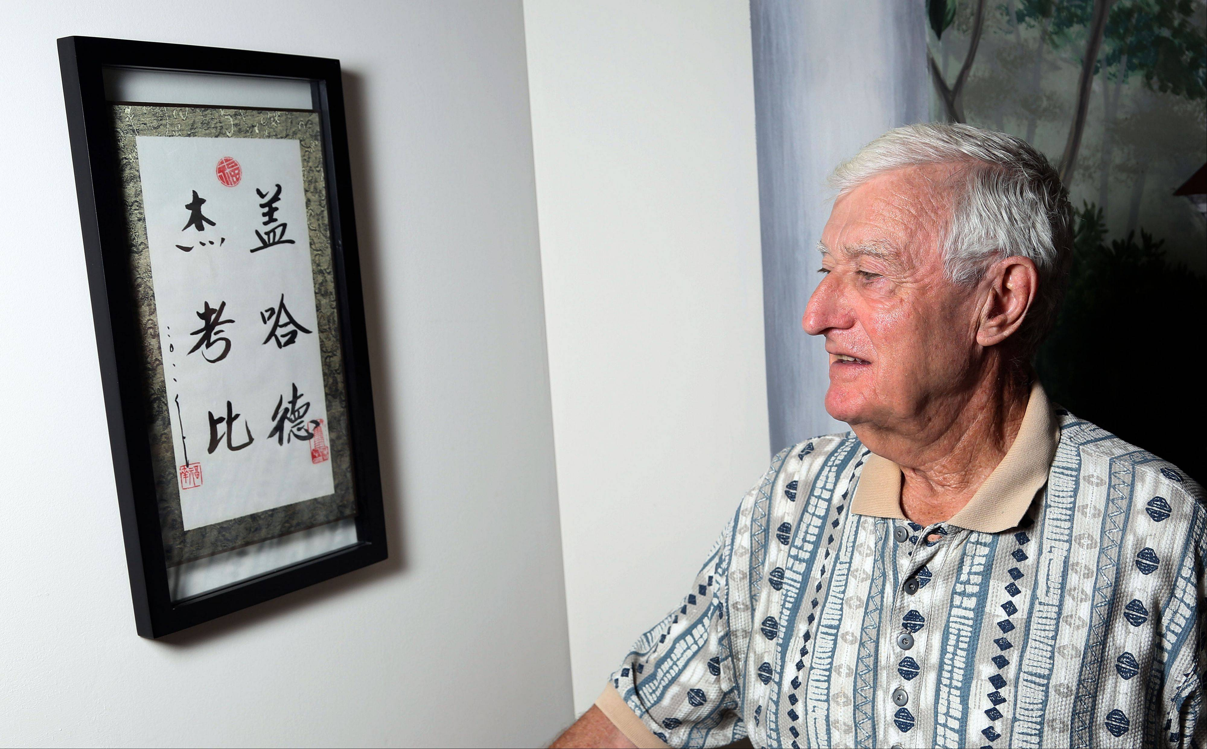 Gerry Jacoby of Lincolnshire looks at Chinese characters that spell his name. Jacoby lived in a ghetto in China to avoid Nazi persecution during World War II.