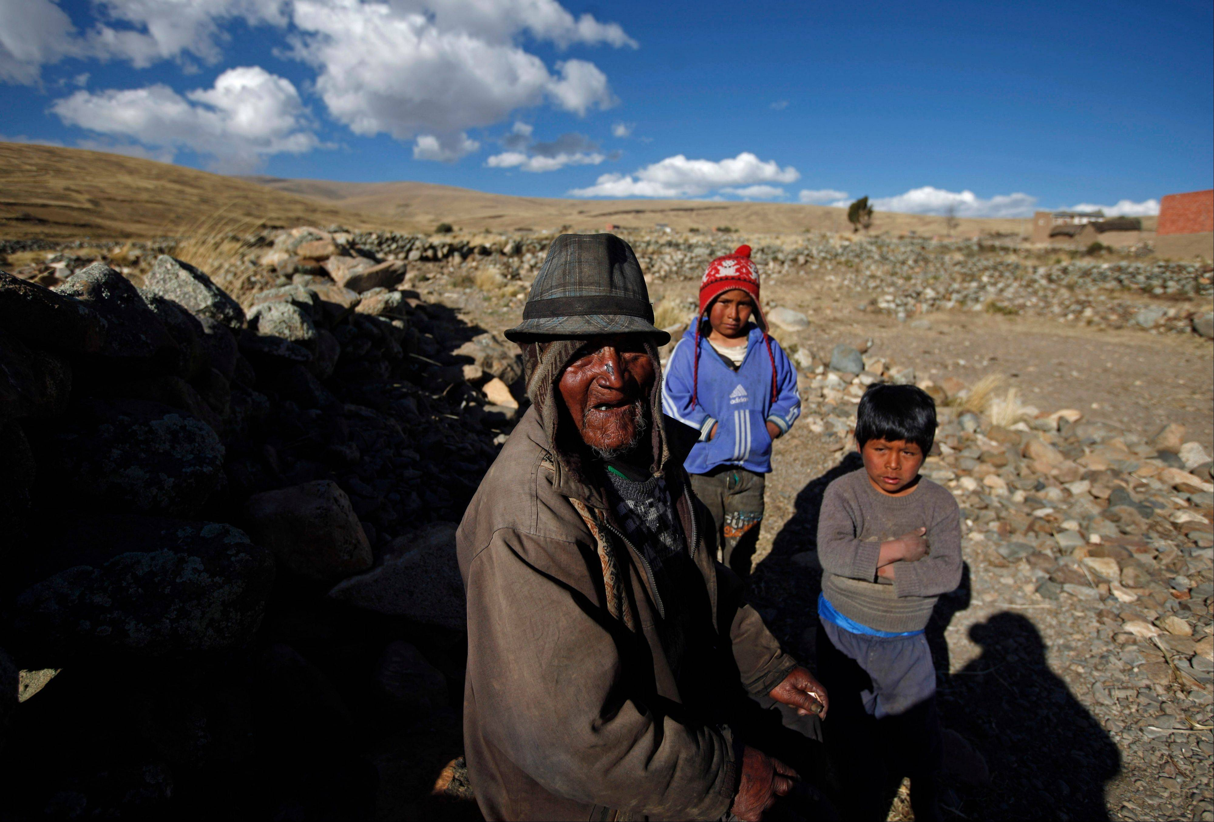 Carmelo Flores Laura, a native Aymara, poses for a photo with his great-grandchildren outside his home in the village of Frasquia, Bolivia, Tuesday, Aug. 13, 2013. If Bolivia�s public records are correct, Flores is the oldest living person ever documented. They say he turned 123 a month ago.