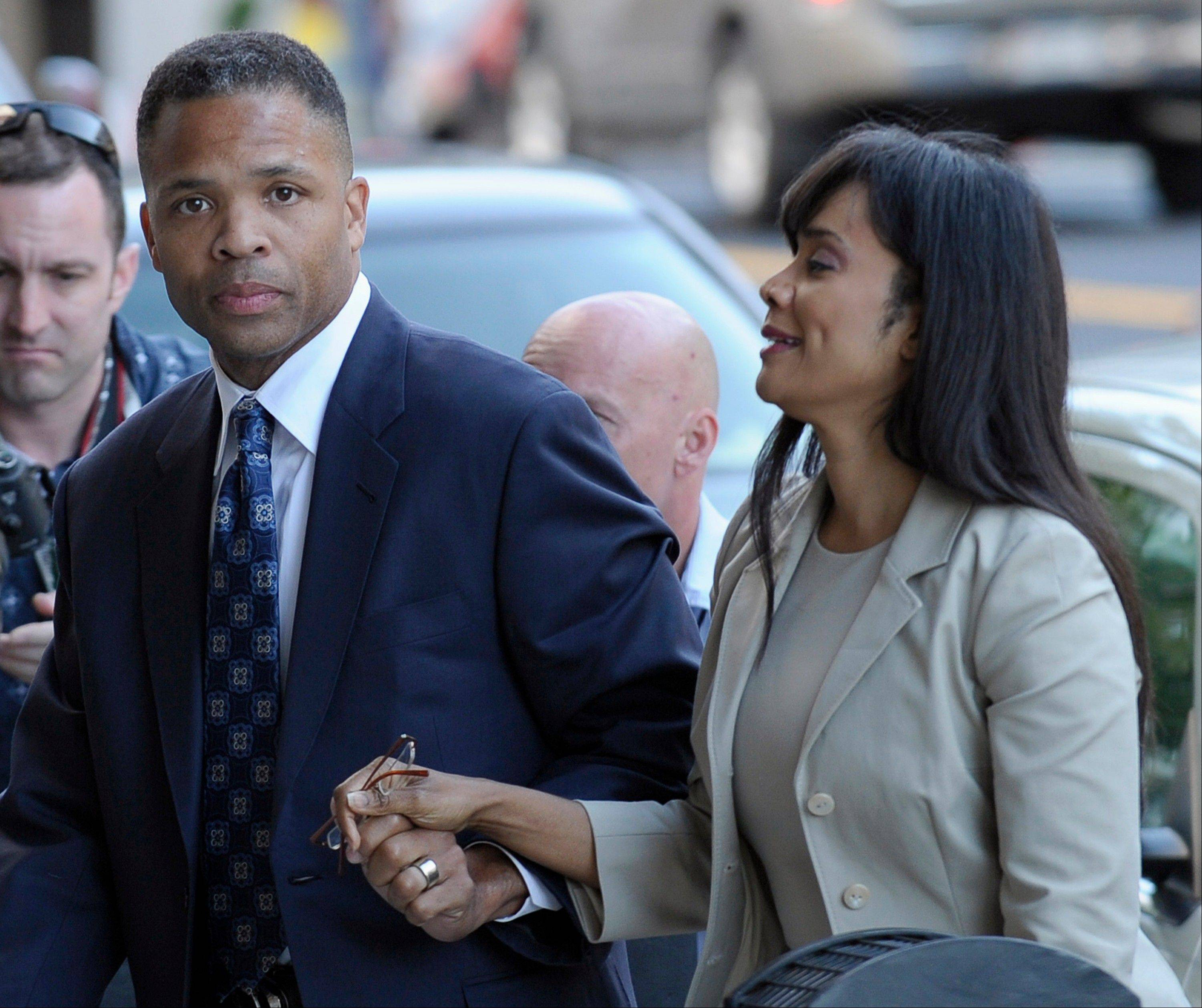 Former U.S. Rep. Jesse Jackson Jr. and his wife, Sandra, arrive at federal court in Washington on Wednesday to learn their fates for misusing $750,000 in campaign money on personal items ranging from a gold-plated Rolex watch and mink capes to vacations and mounted elk heads.