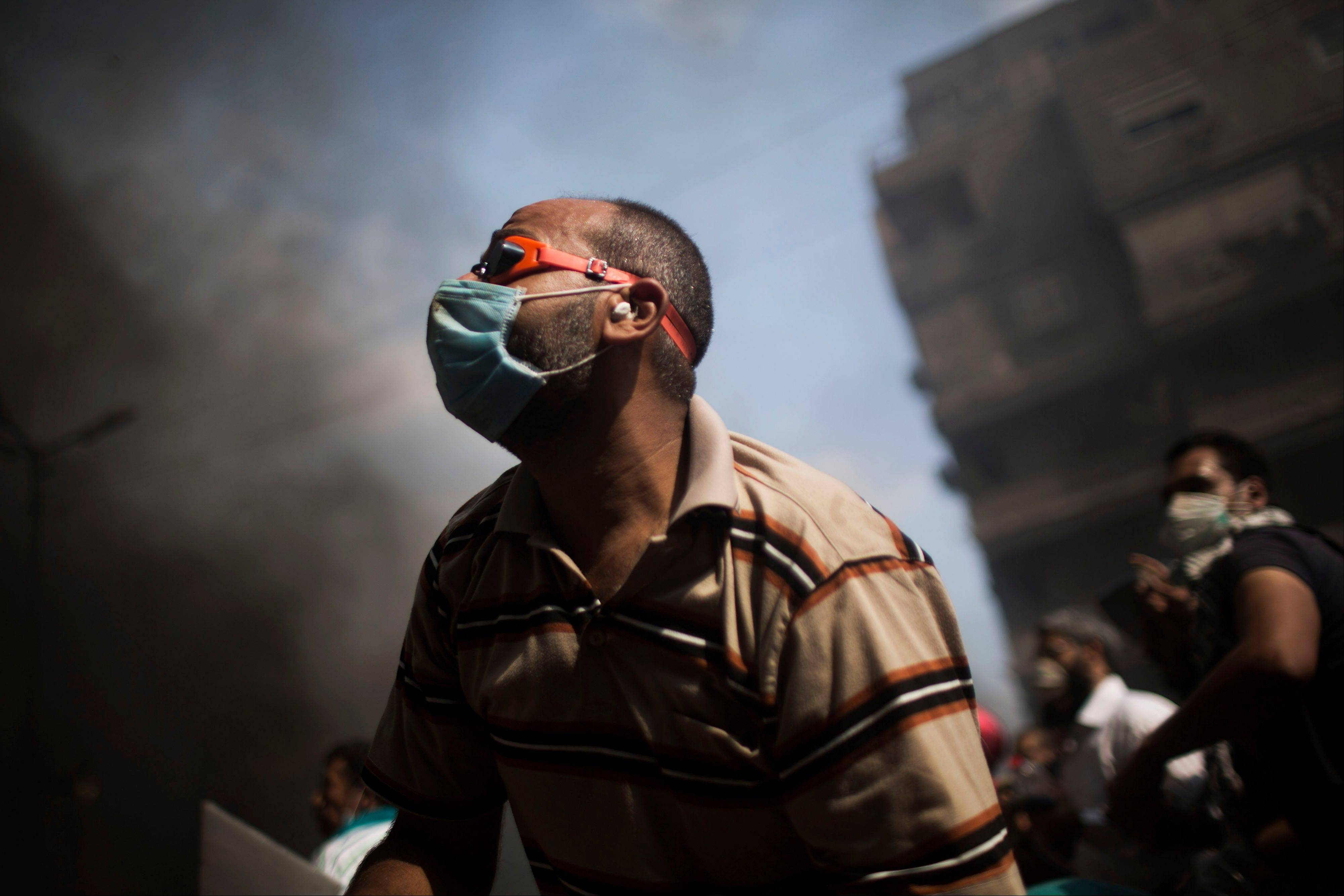Supporters of ousted Egyptian President Mohammed Morsi clash with security forces in Cairo�s Nasr City district Wednesday.