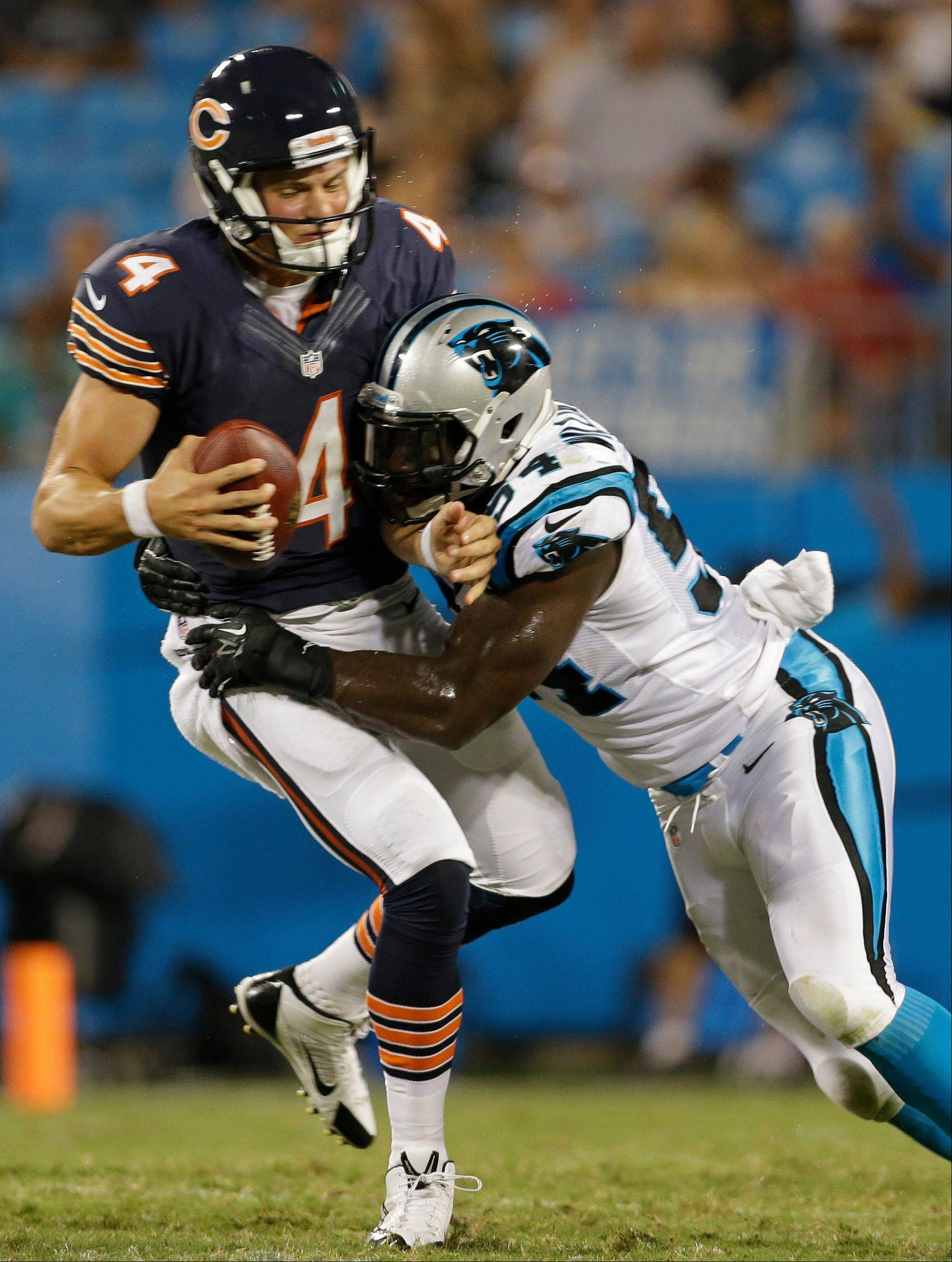 Bears quarterback Matt Blanchard is hit by the Panthers� Jason Williams on Friday during preseason action in Charlotte, N.C.