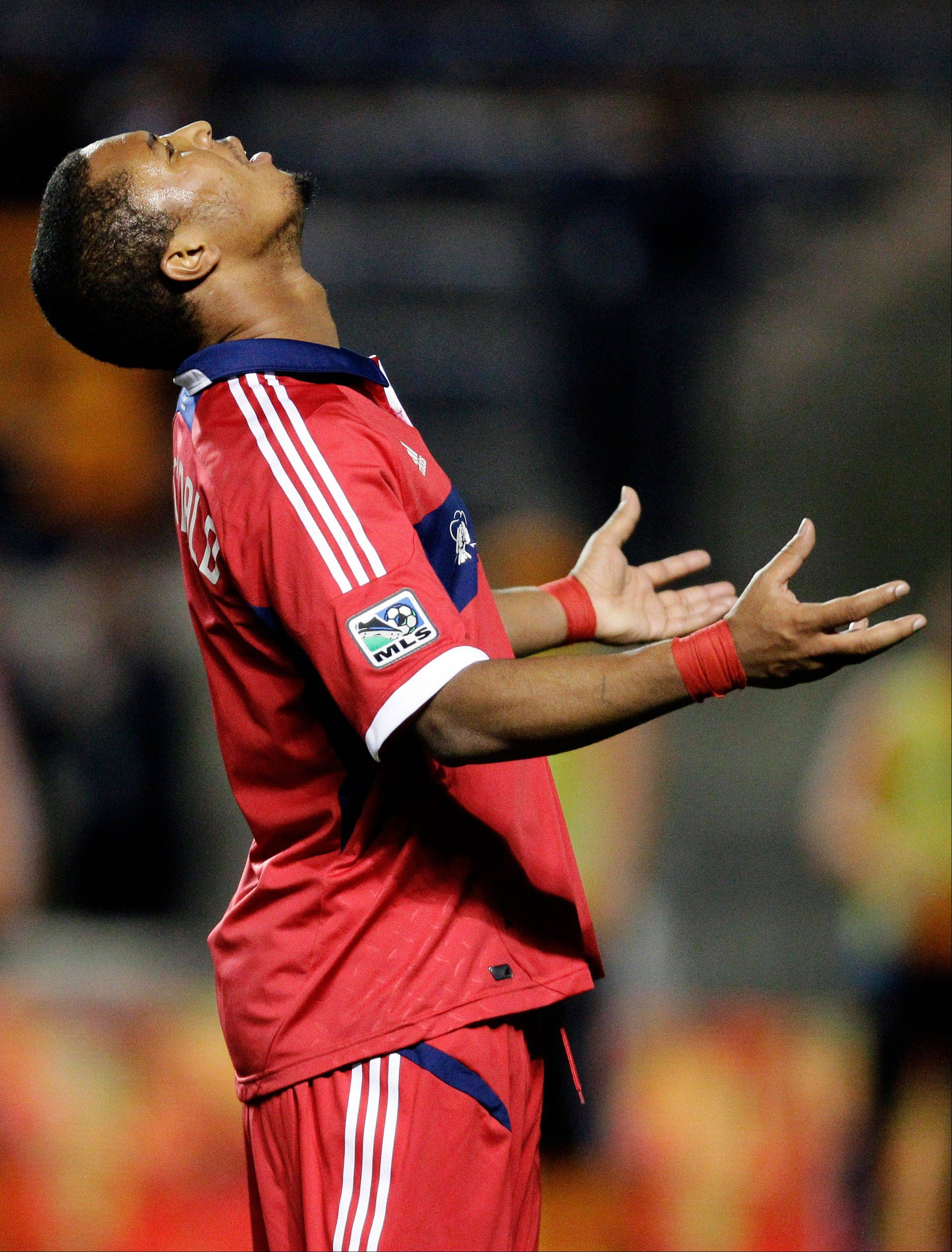 Chicago Fire forward Sherjill MacDonald (7) reacts after missing a pass against the Houston Dynamo during the second half of their MLS soccer playoff match, Wednesday, Oct. 31, 2012, in Bridgeview, Ill. Houston won 2-1. (AP Photo/Nam Y. Huh)