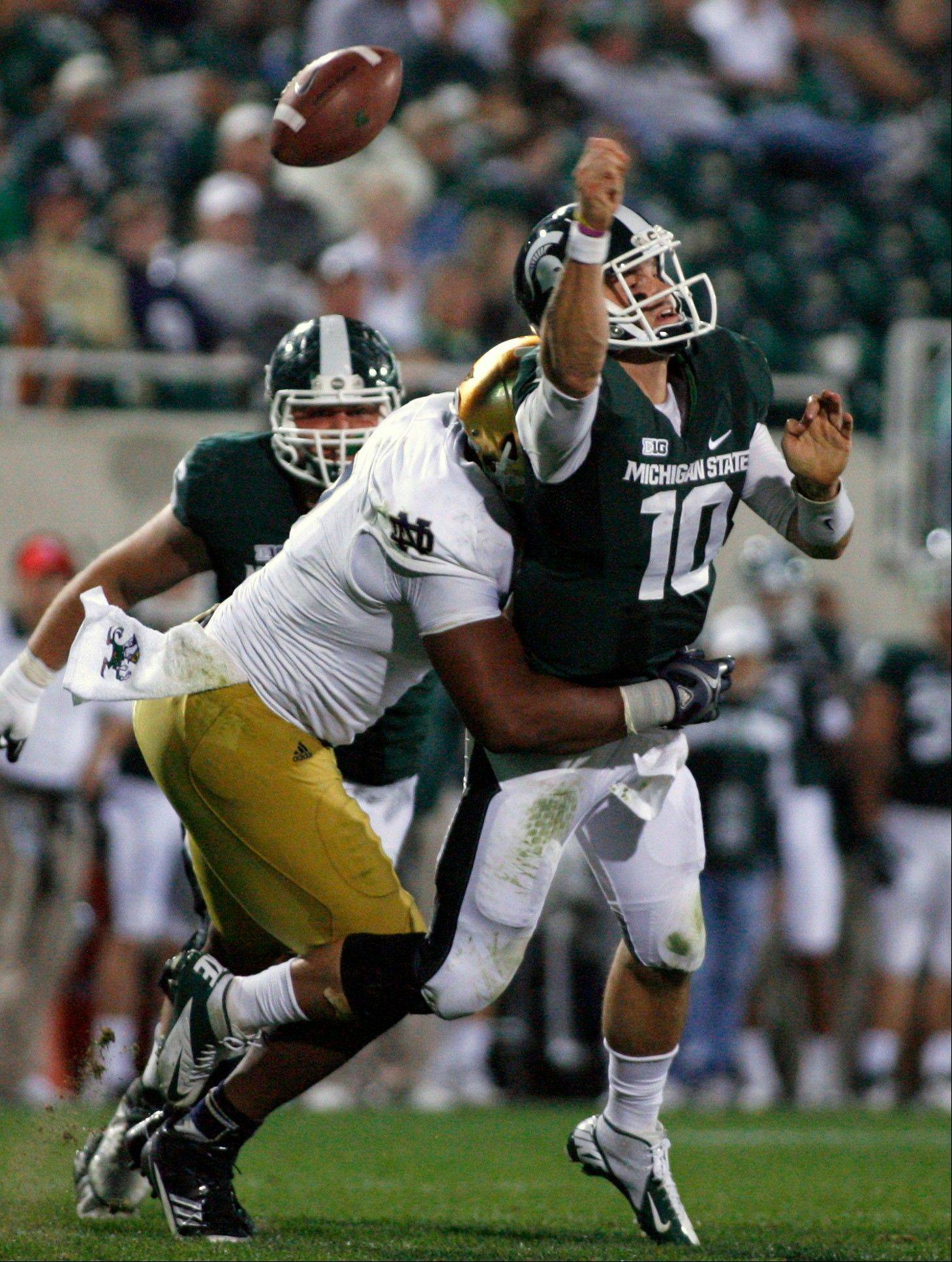 Michigan State quarterback Andrew Maxwell fumbles the ball as he is hit by Notre Dame�s T.J. Jones on Sept. 15, 2012. Maxwell completed only 52.5 percent of his passes last season.