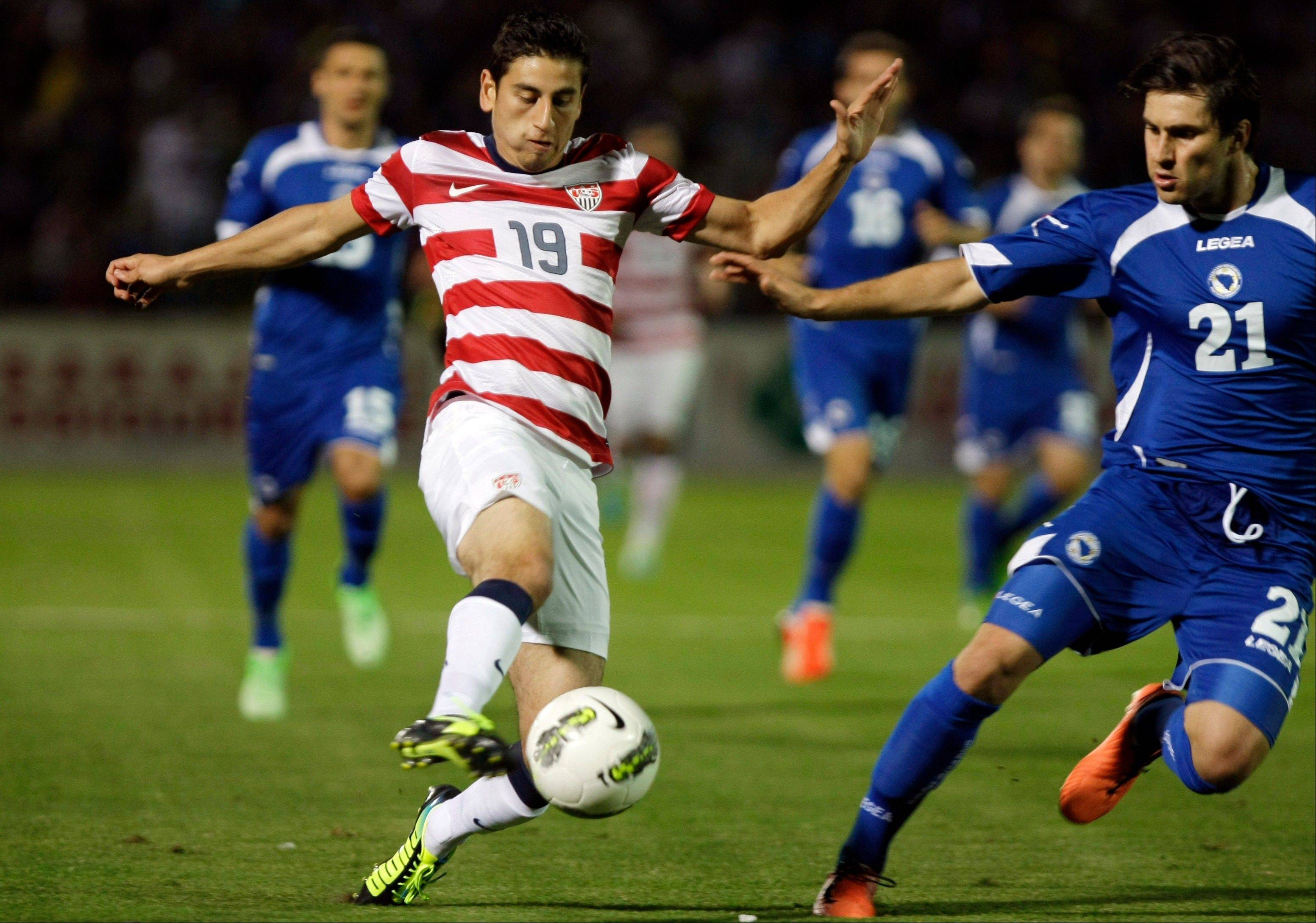 Alejandro Bedoya of Team USA, left, challenges Bosnia�s Ervin Zukanovic during their friendly soccer match Wednesday in Sarajevo.