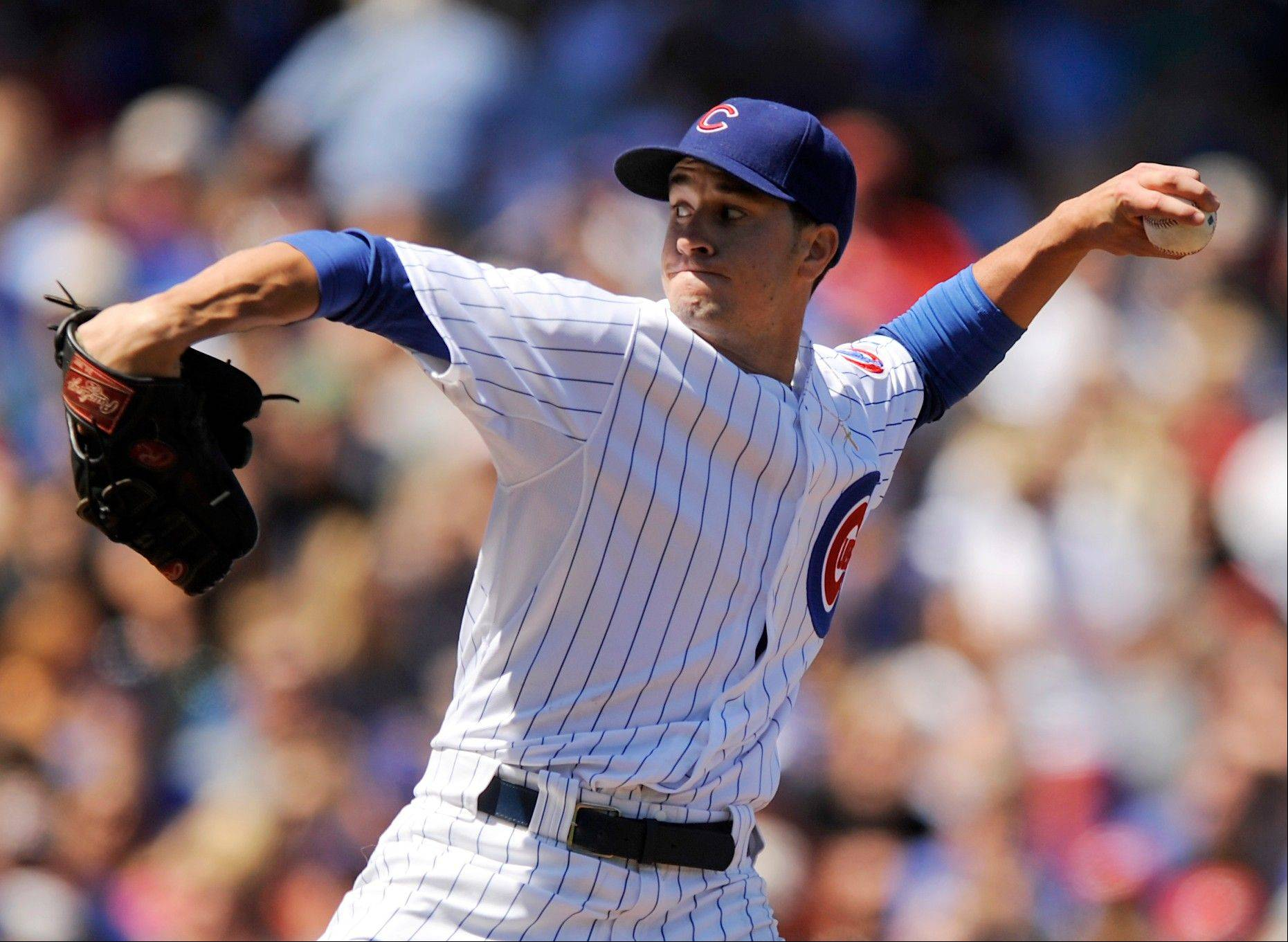 Cubs starter Chris Rusin delivers a pitch Wednesday during the first inning against the Cincinnati Reds at Wrigley Field.