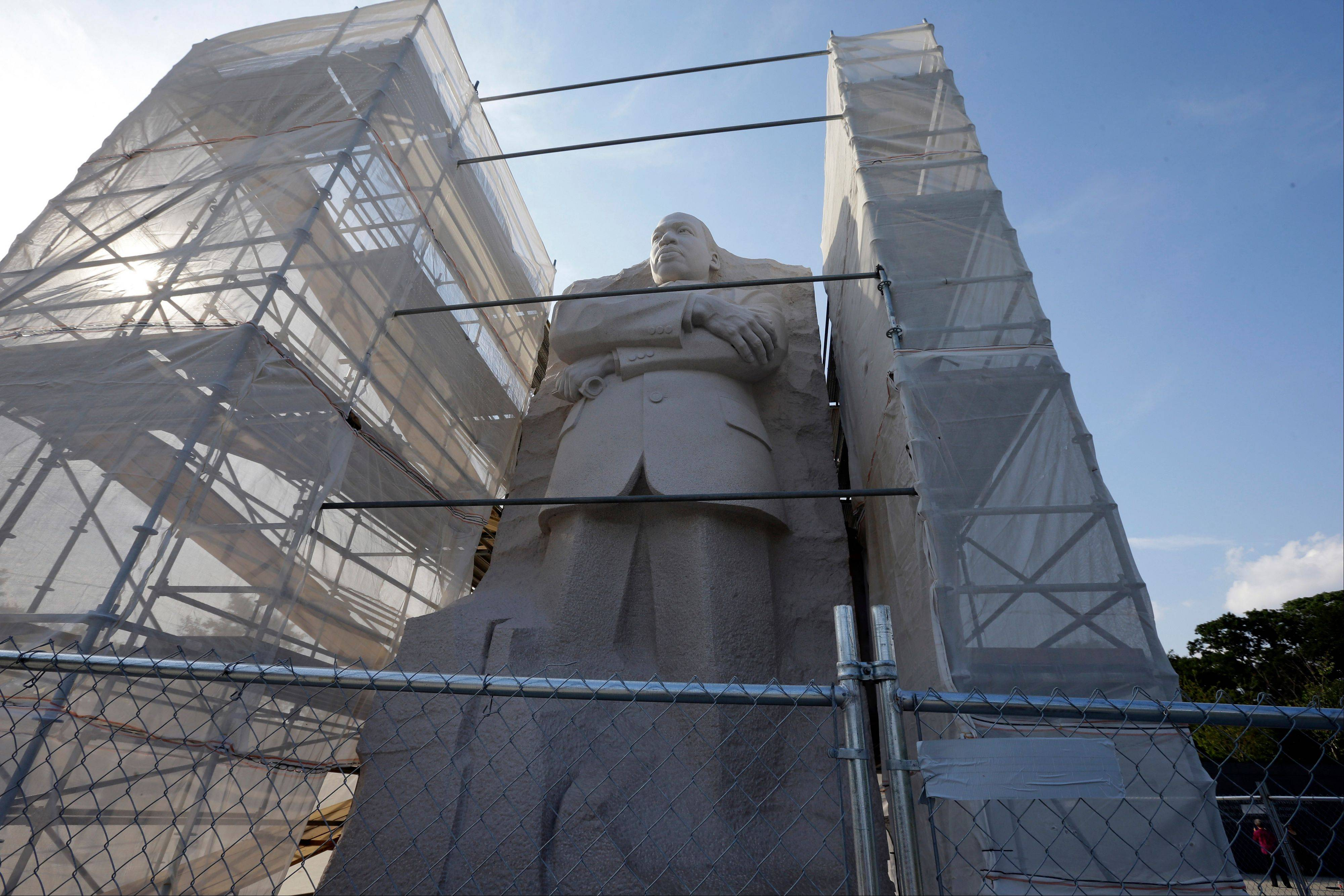 The Martin Luther King, Jr. Memorial has shrouded scaffolding on both sides. A contracting problem has stalled work to refinish part of the Martin Luther King Jr. Memorial where a disputed inscription was recently removed.