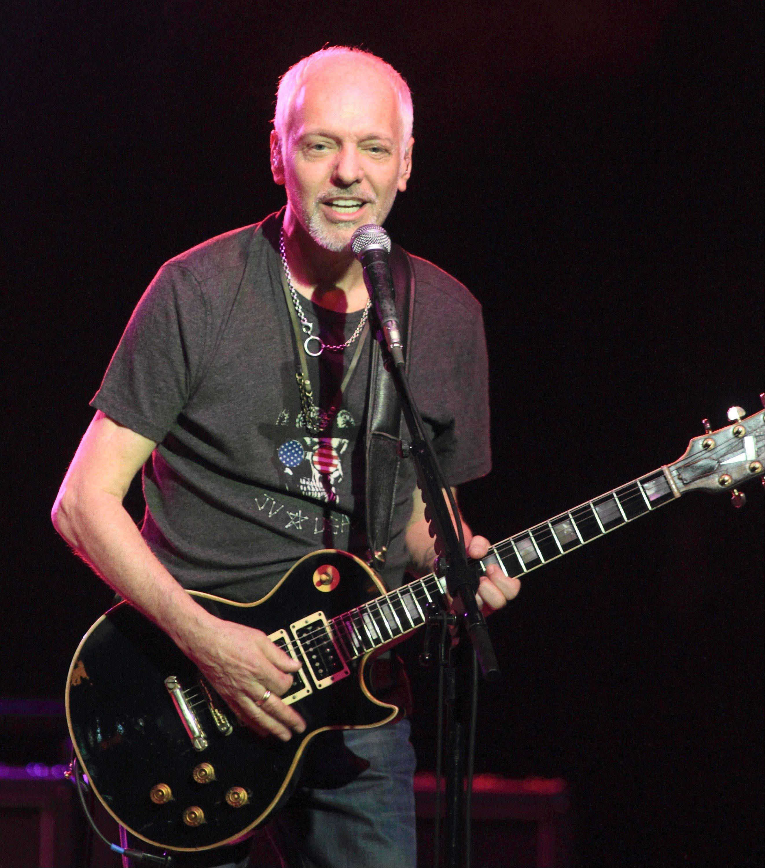 "Singer-songwriter Peter Frampton performs during ""Peter Frampton's Guitar Circus"" Friday at RiverEdge Park in Aurora."