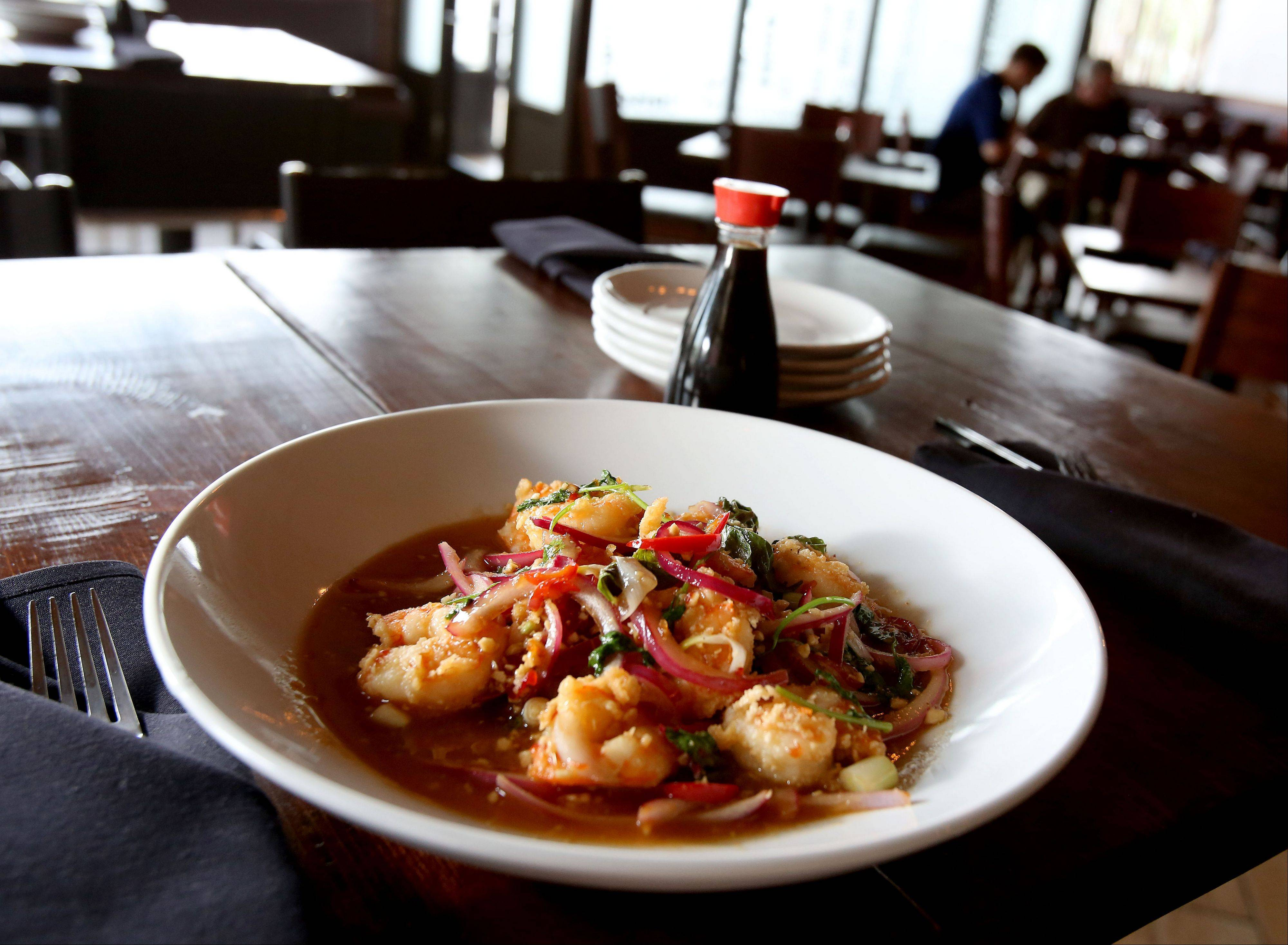 8,000 Miles' Thai basil shrimp draws flavor from its wild-caught seafood, Thai basil leaves, cilantro, red onions, roasted peanuts and cherry chilies.