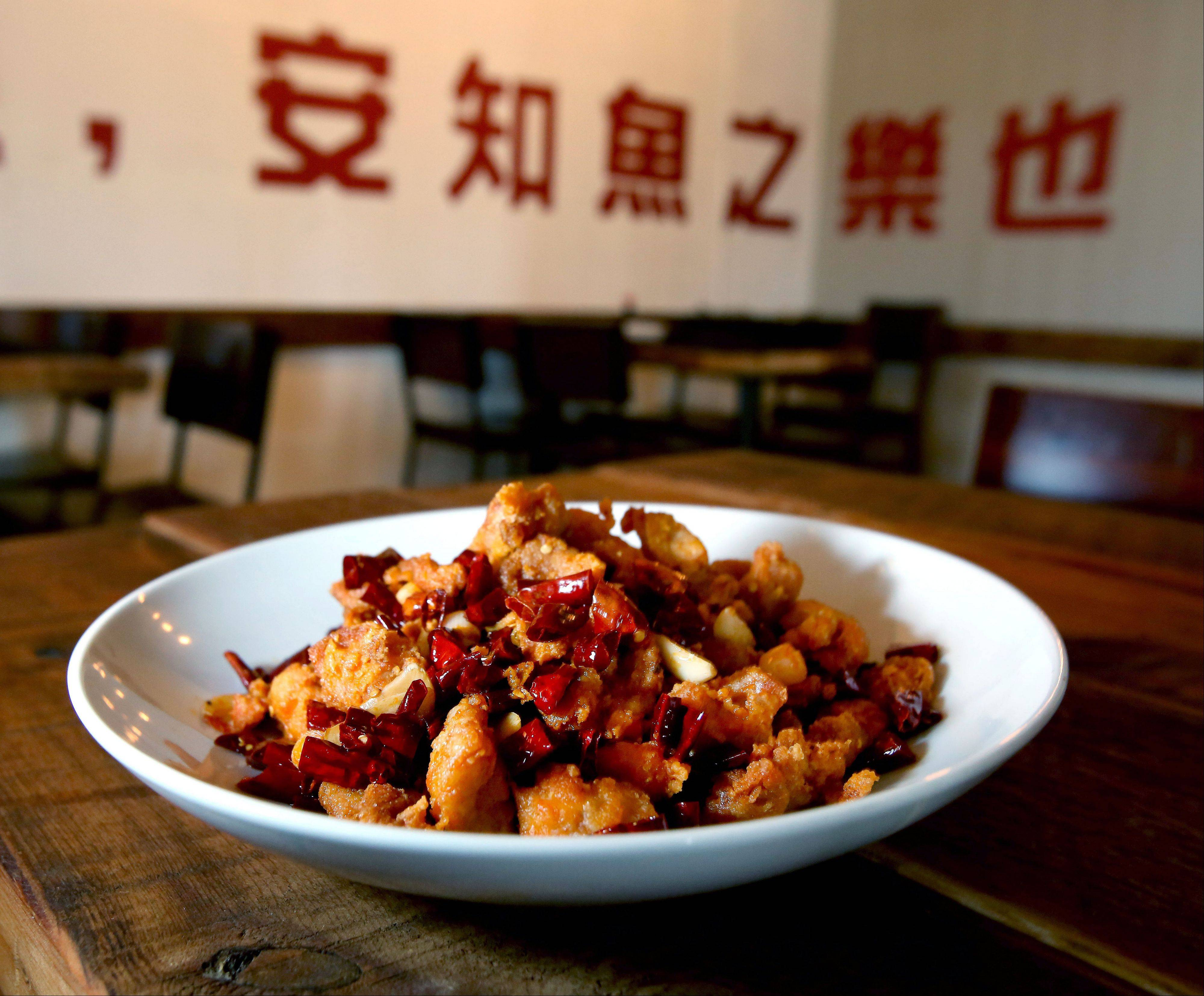 8,000 Miles' dried chili chicken gets its kick from blackened chilis, chili oil and garlic.