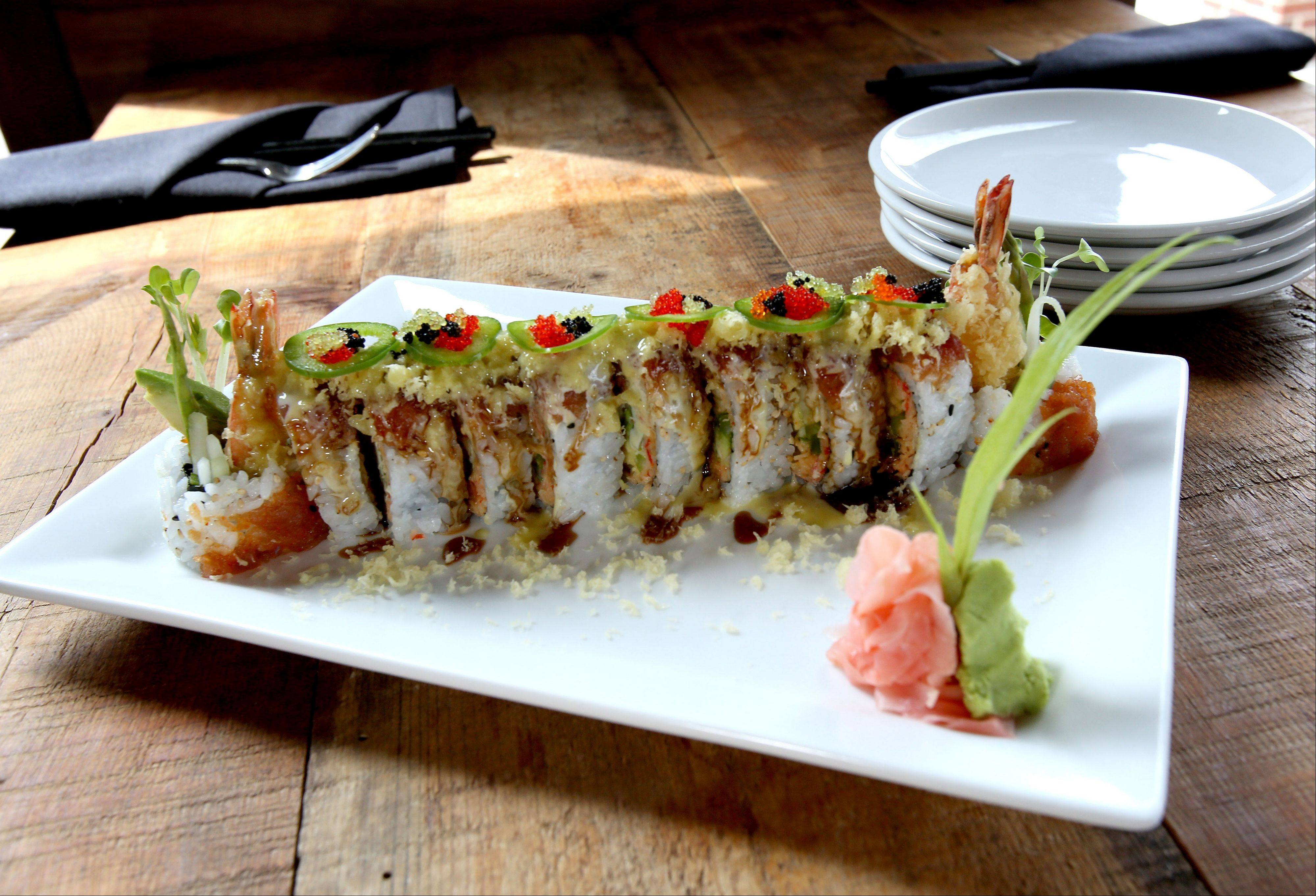 8,000 Miles' Roselle Roll brings together shrimp tempura, asparagus, jalape�o, avocado, cucumber and spicy crabmeat maki. It's topped with spicy tuna, tempura crunch and mixed tobikos and drizzled with eel sauce, honey wasabi and house spicy sauce.