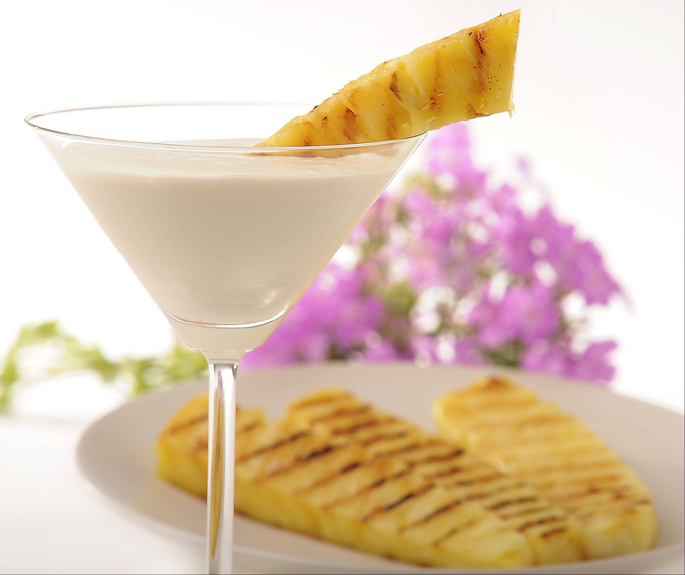 Grilled pineapple with orange-infused sauce is a refreshing treat on a hot summer day.