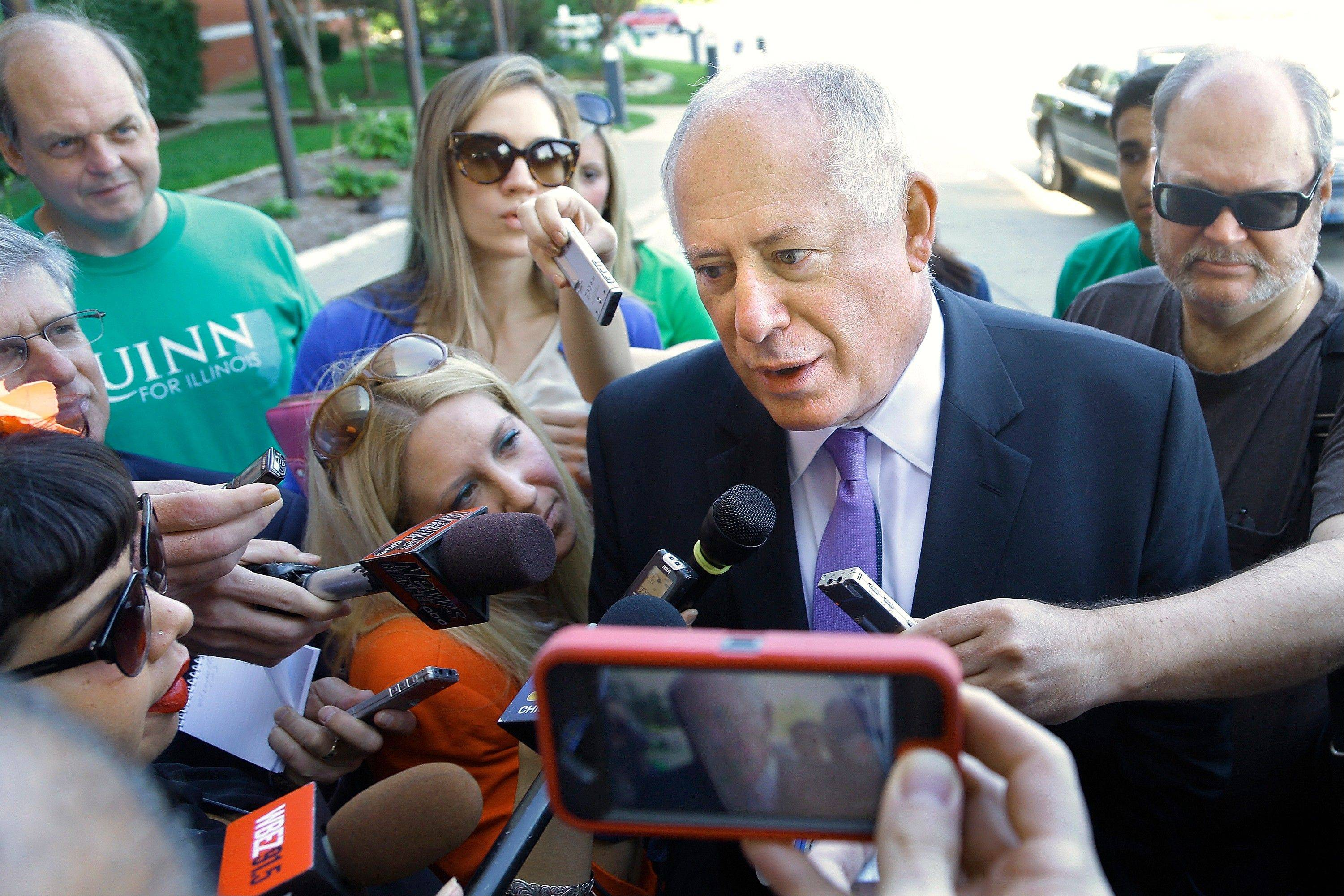 Gov. Pat Quinn speaks to reporters Wednesday in Springfield. Quinn, who is facing at least one challenge from former White House Chief of Staff Bill Daley, vowed to beat anyone who opposed him in the election.