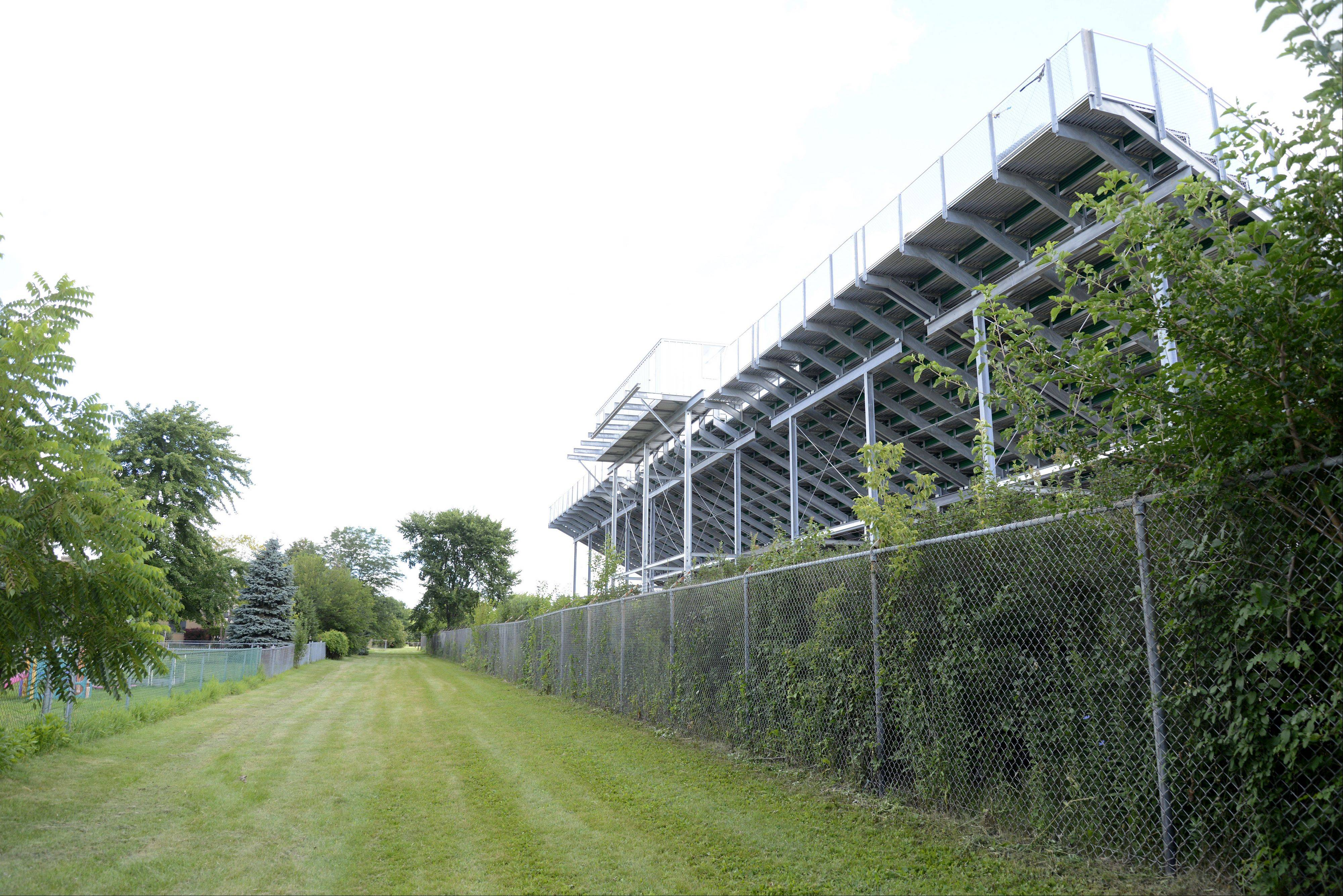 Crystal Lake South High School installed bleachers on the west side of the football field, and three residents of Amberwood Drive -- including McHenry County State's Attorney Louis Bianchi -- have sued the school district.