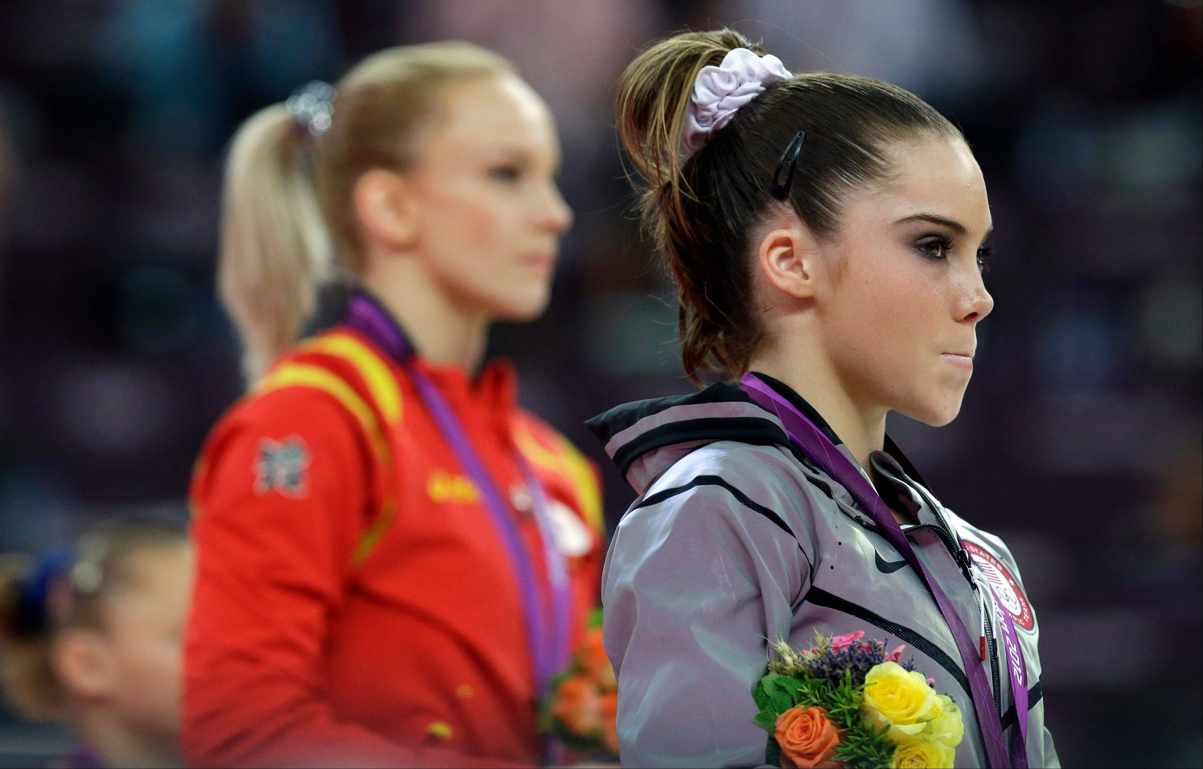 Silver medalist McKayla Maroney, right, stands with gold medalist Sandra Raluca Izbasa of Romania during the podium ceremony for women's vault finals at the 2012 Summer Olympics in London.