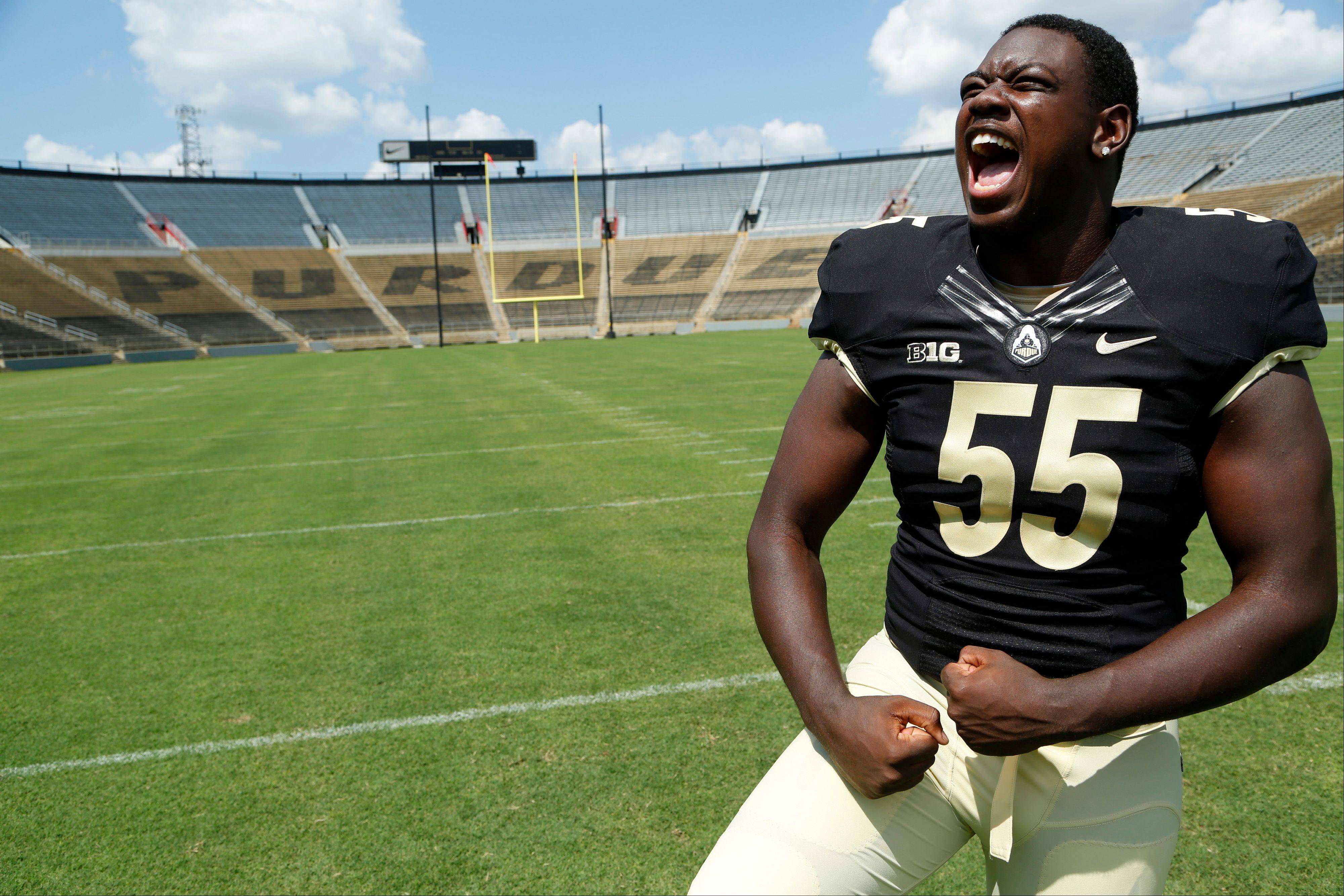 Purdue's Antoine Miles strikes a pose during media day on Sunday at Ross-Ade Stadium in West Lafayette, Ind.