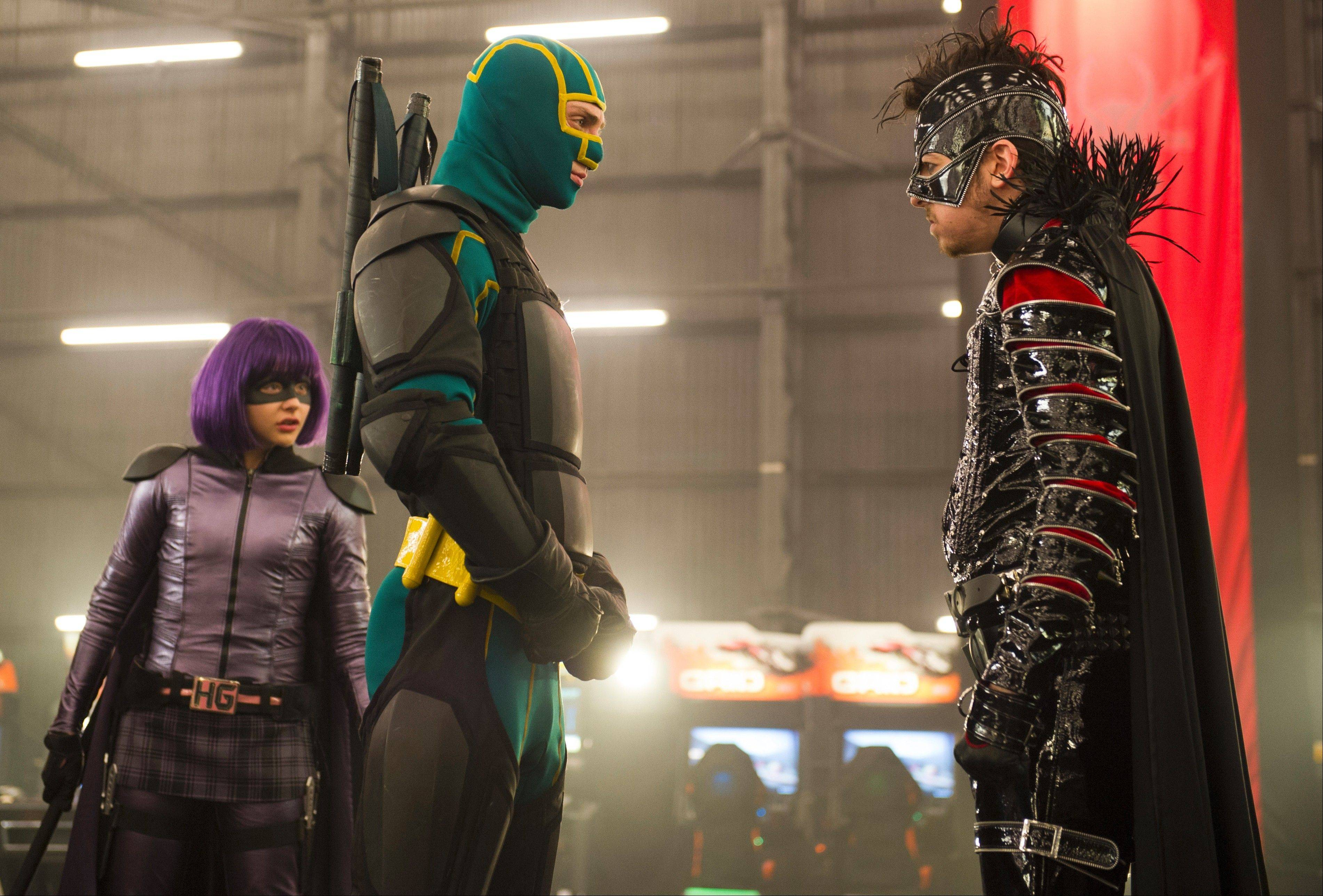 "Superheroes Hit Girl (Chloe Grace Moretz) and Kick-Ass (Aaron Taylor-Johnson), center, confront a criminal mastermind (Christopher Mintz-Plasse) in ""Kick-Ass 2."""