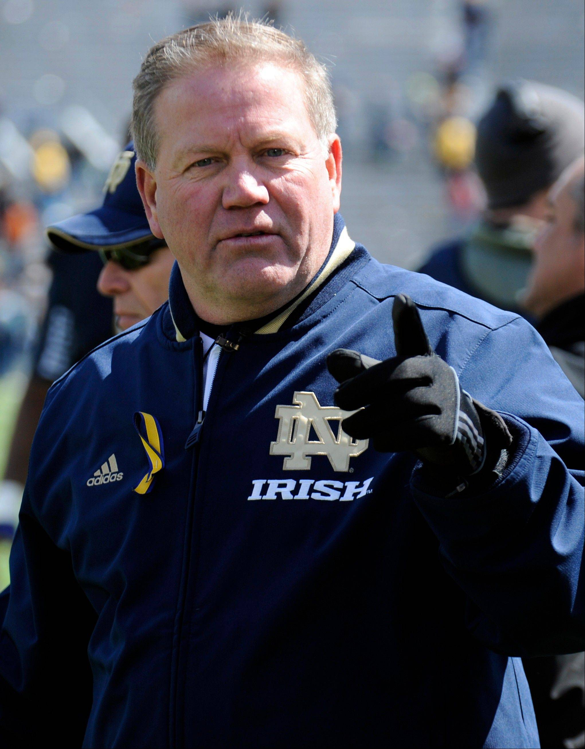Notre Dame coach Brian Kelly heads off the field after the Blue-Gold spring game in South Bend, Ind. Kelly thinks the Irish�s recent problems are behind them.