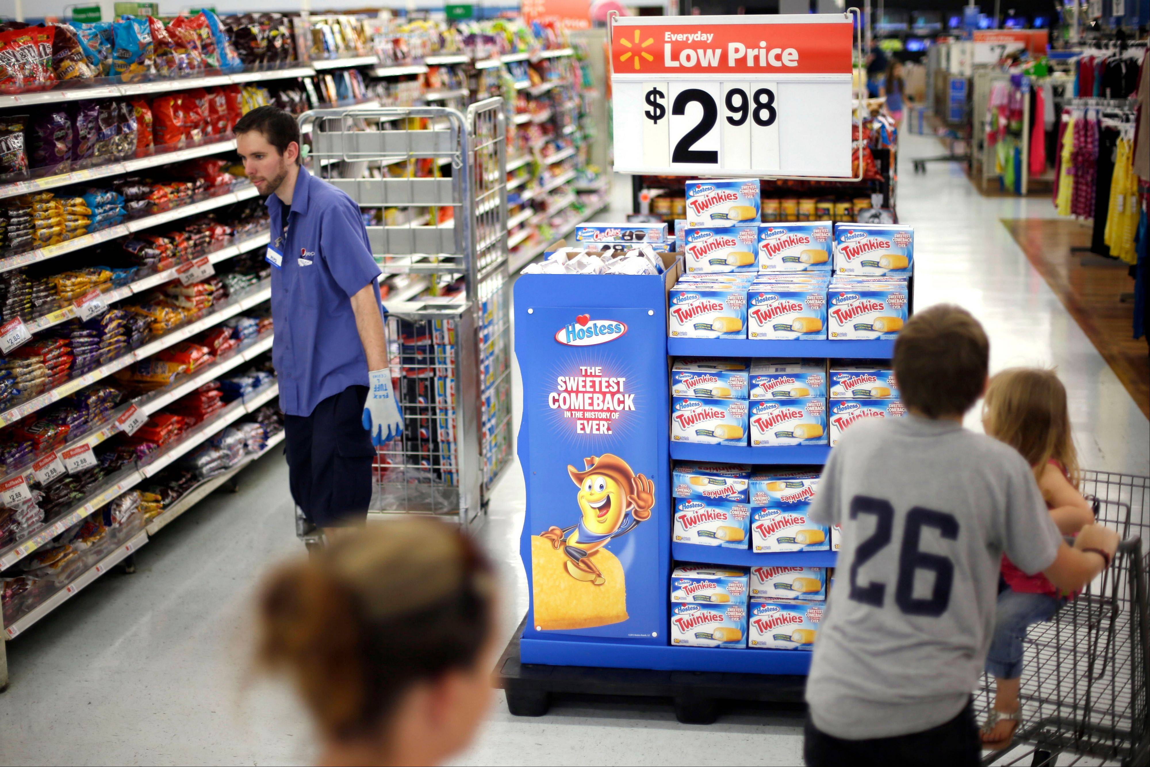 Shoppers peruse the aisles at a Wal-Mart in Bristol, Pa. Wal-Mart lost at least 2.6 percent after reporting earnings on Thursday.