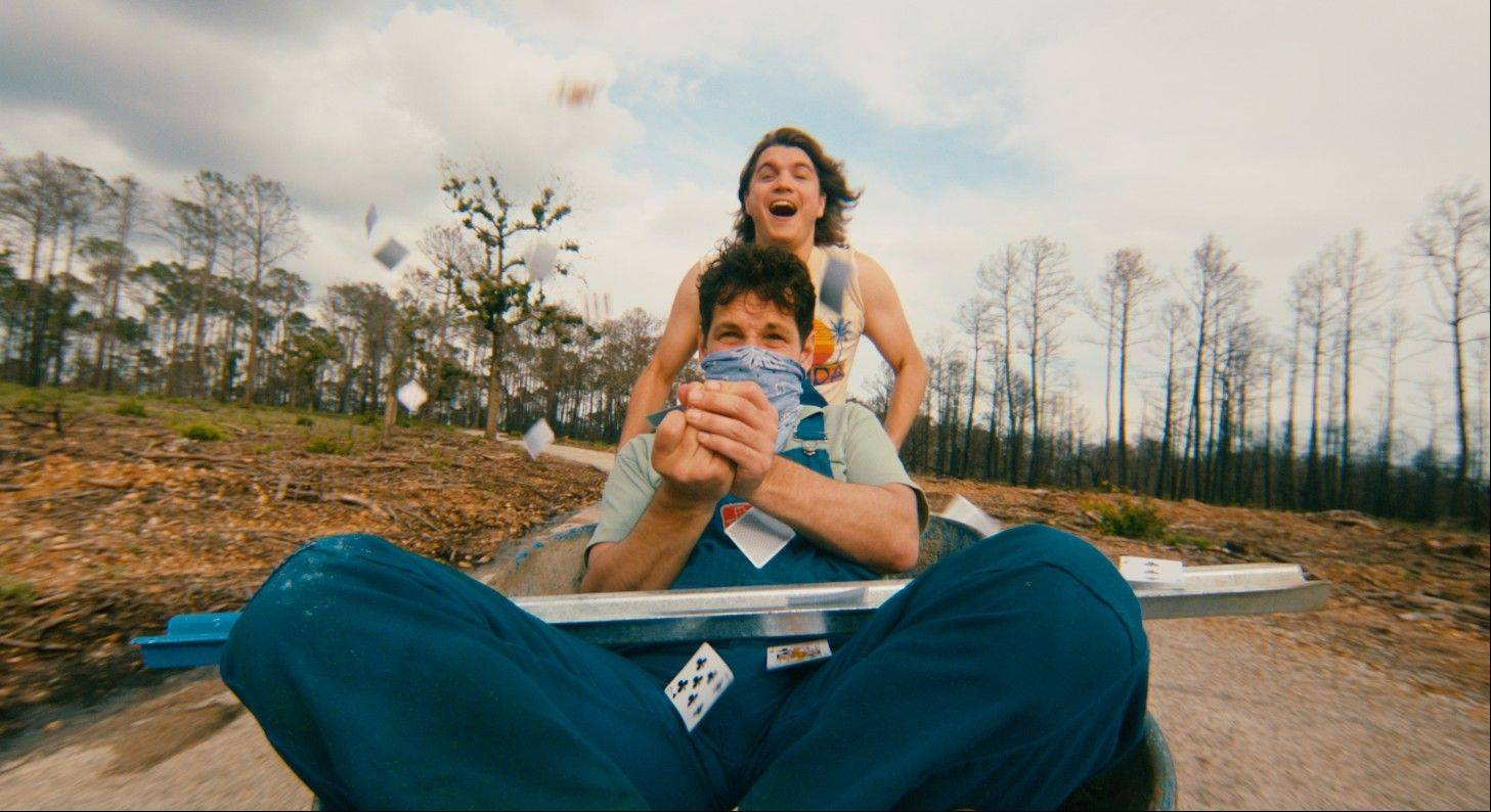"Emile Hirsch, top, and Paul Rudd play two opposite personalities stuck on road maintenance duties in David Gordon Green's art house drama ""Prince Avalanche."""
