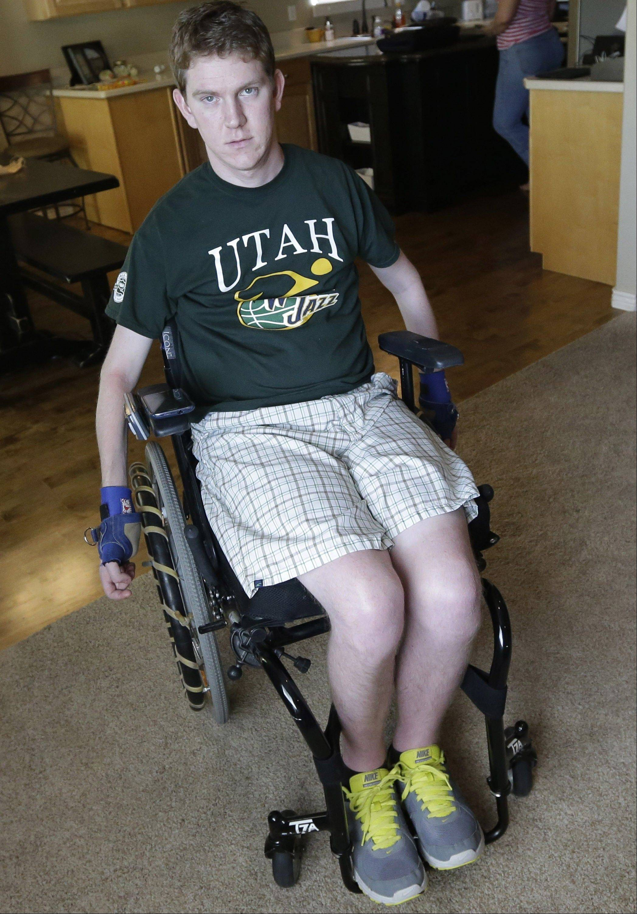 Stephen Merrill sits on his wheelchair at his home in Highland, Utah. Merrill broke a vertebra in his neck, and was left paralyzed from the neck down during a trampoline accident.