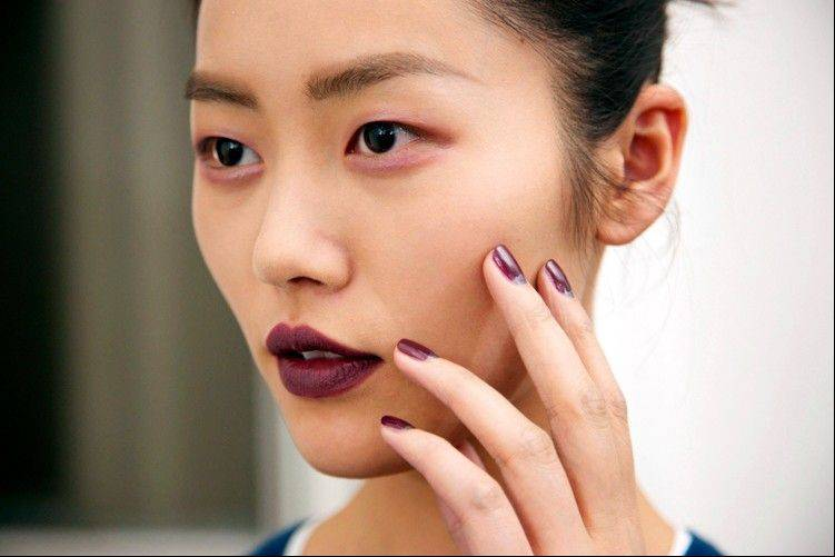 Model Liu Wen wears Plum Couture in the Anthony Vaccarello Fall 2013 Show in Paris. Makeup with menswear is a little more important than other styles because with a neutral, muted palette of grays, blacks and browns.