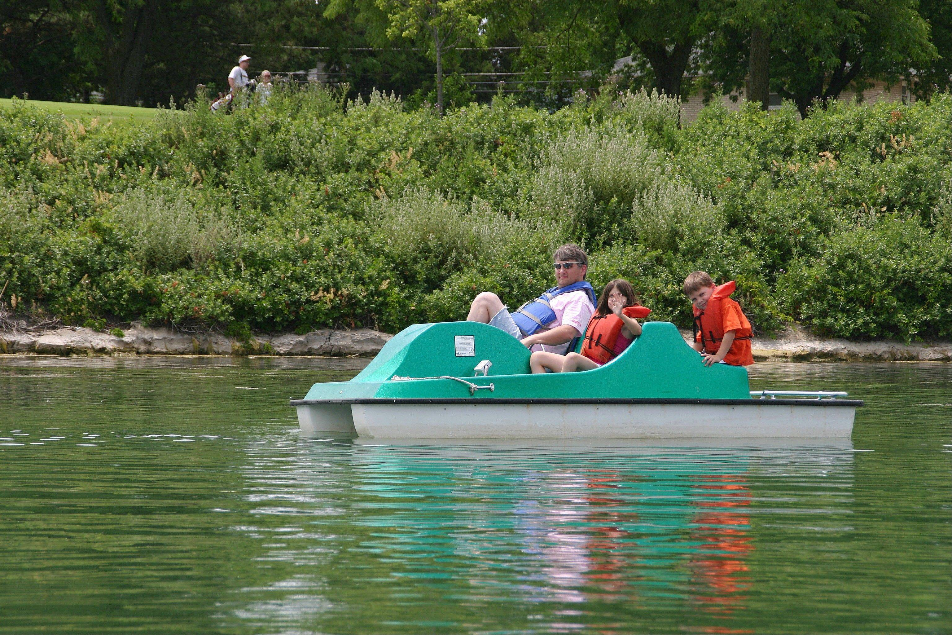 Paddleboat riders wear life jackets as part of the safety protocol at the Lake Park marina.