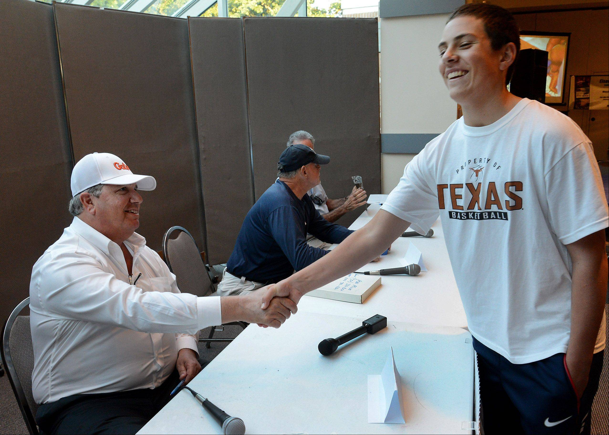 "Sam Fishman of Buffalo Grove, right, shakes hands with former White Sox pitcher Ross Baumgarten during ""A Night of Jewish Baseball"" at Congregation Beth Judea in Long Grove."